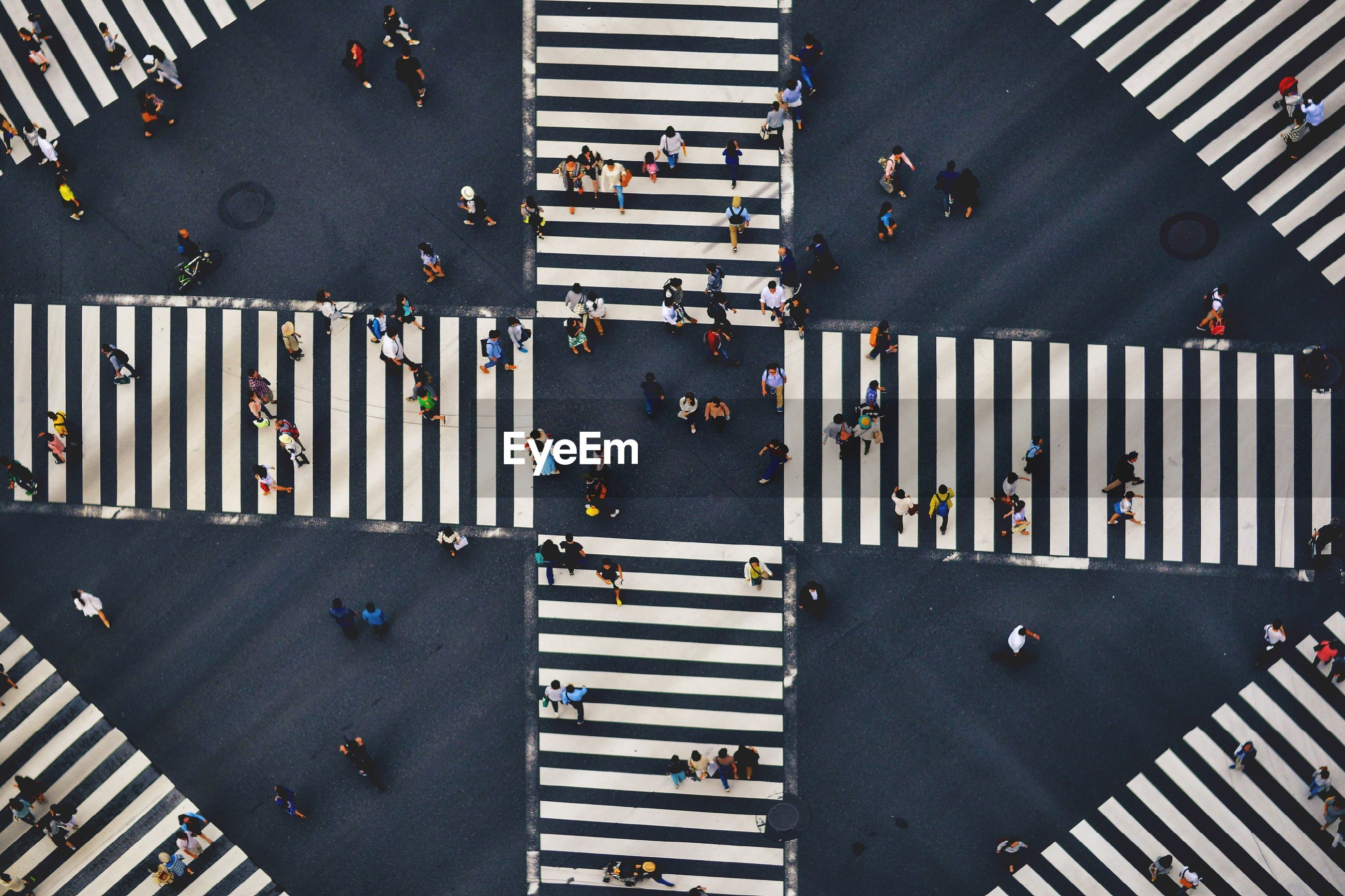 High angle view of people crossing the street
