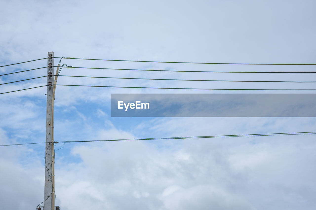 cable, sky, cloud - sky, electricity, power line, low angle view, power supply, connection, technology, fuel and power generation, no people, day, nature, metal, outdoors, built structure, blue, architecture, electrical equipment, beauty in nature, telephone line