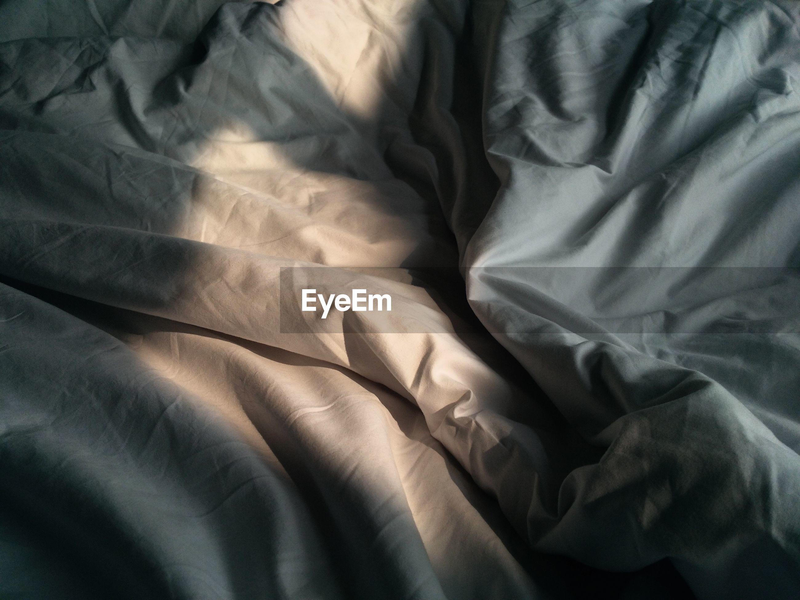 Full frame shot of sheet on bed at home
