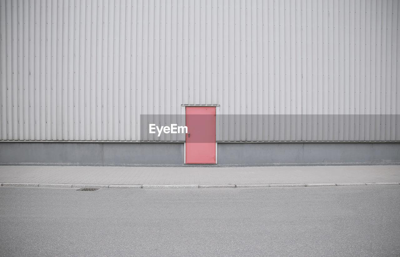 CLOSED RED DOOR ON BUILDING
