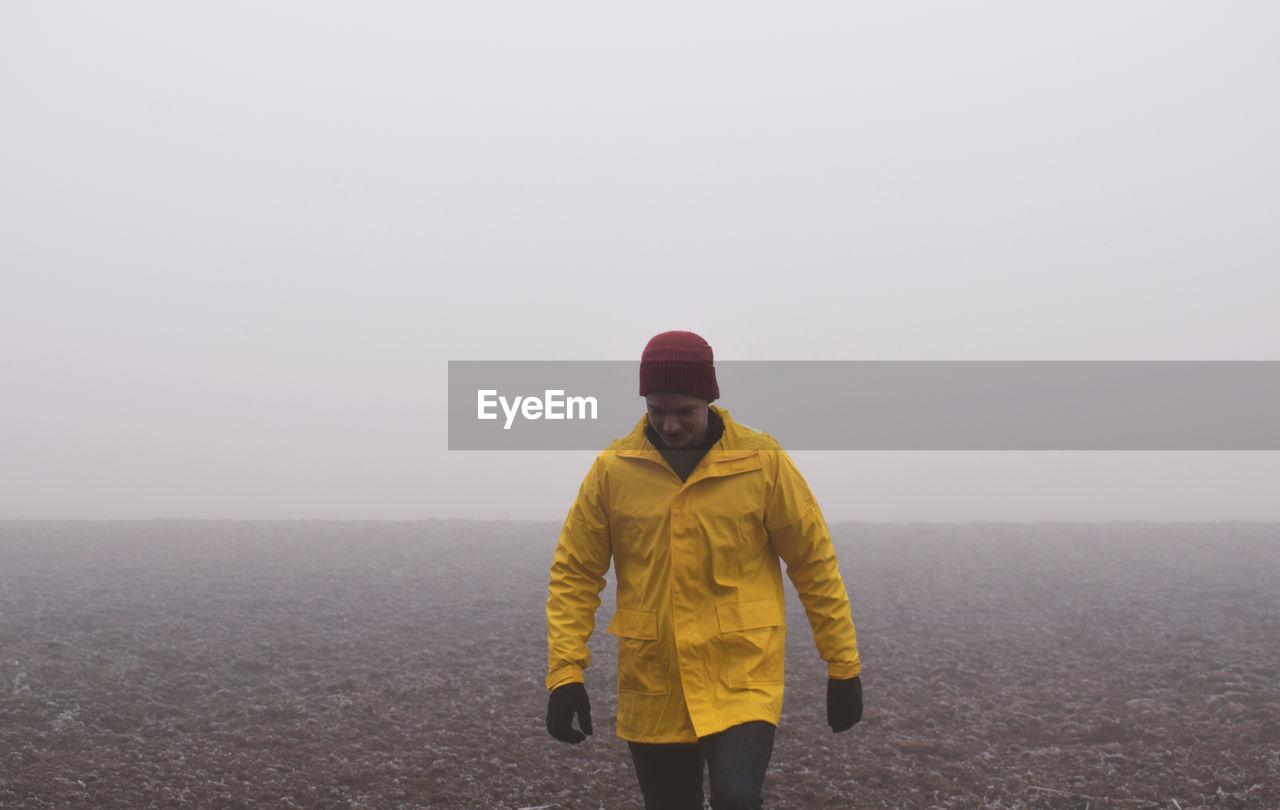Man walking against clear sky