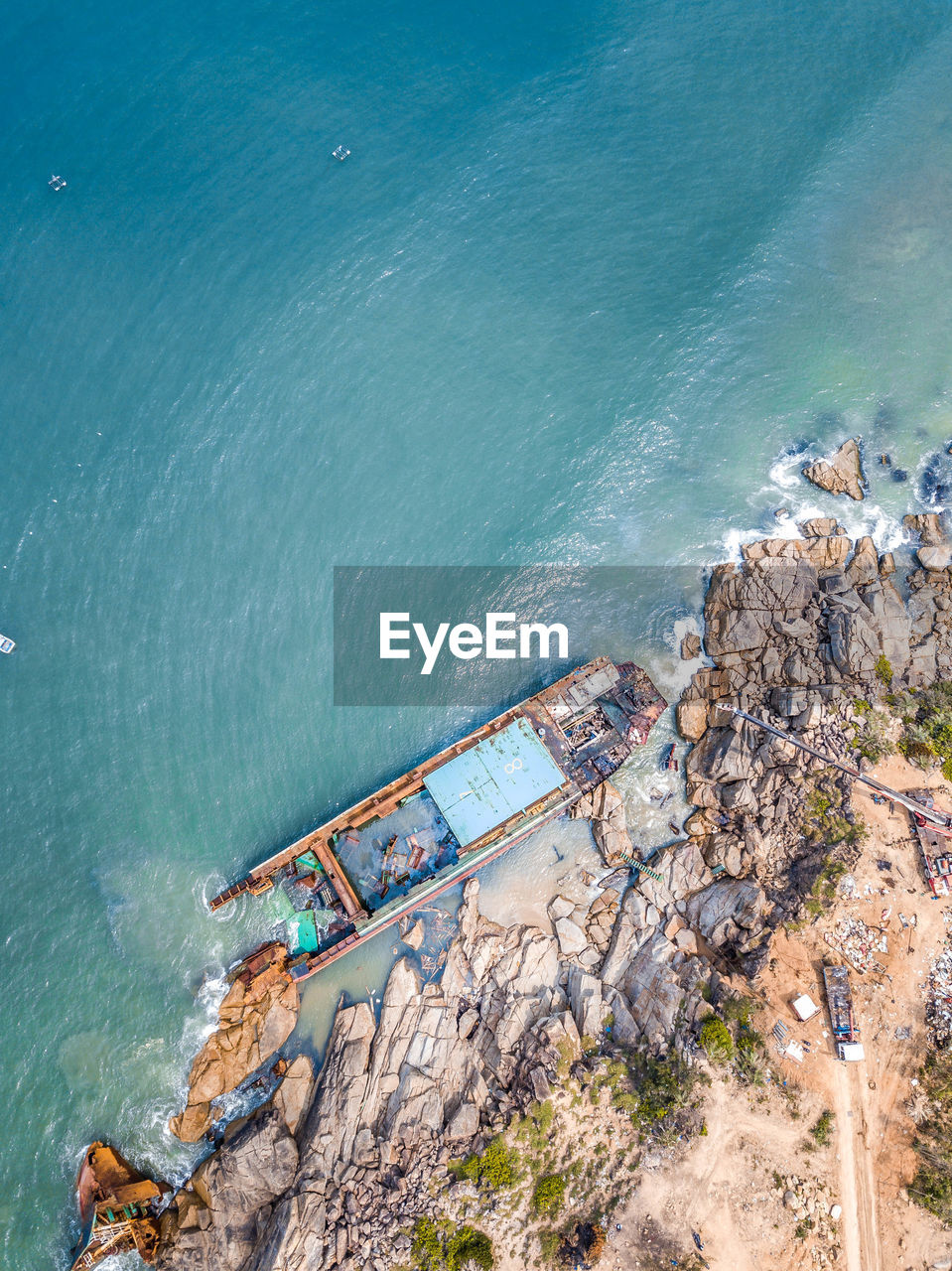 Aerial view of boat by sea coast