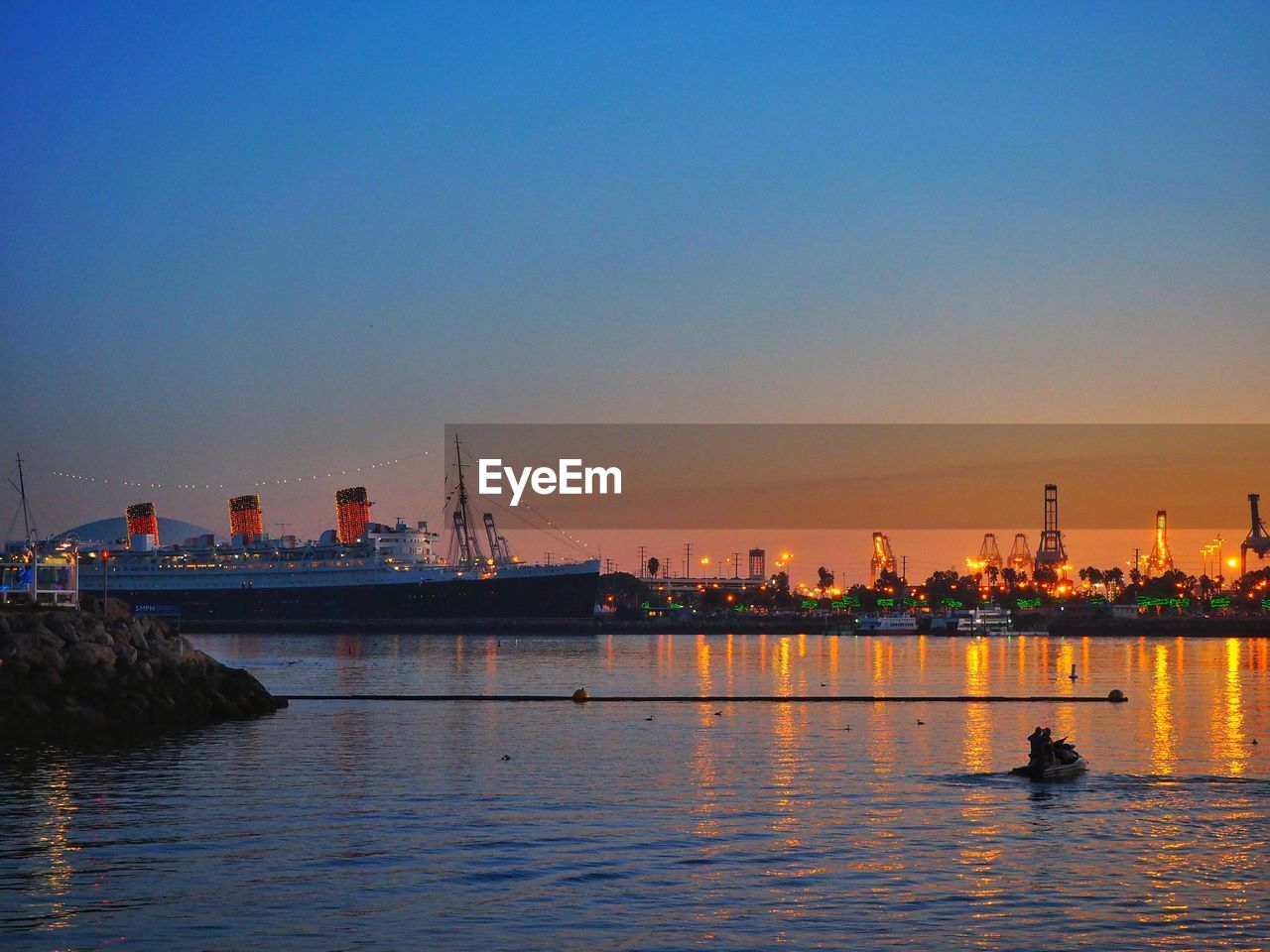 water, waterfront, nautical vessel, transportation, built structure, mode of transport, river, sunset, architecture, building exterior, outdoors, no people, clear sky, nature, harbor, city, sky, day