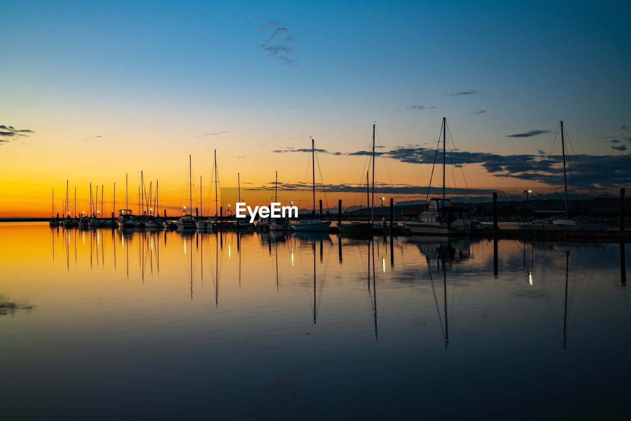 water, sky, sunset, nautical vessel, transportation, reflection, mode of transportation, sailboat, moored, waterfront, harbor, no people, mast, beauty in nature, pole, nature, tranquility, scenics - nature, marina, outdoors, yacht
