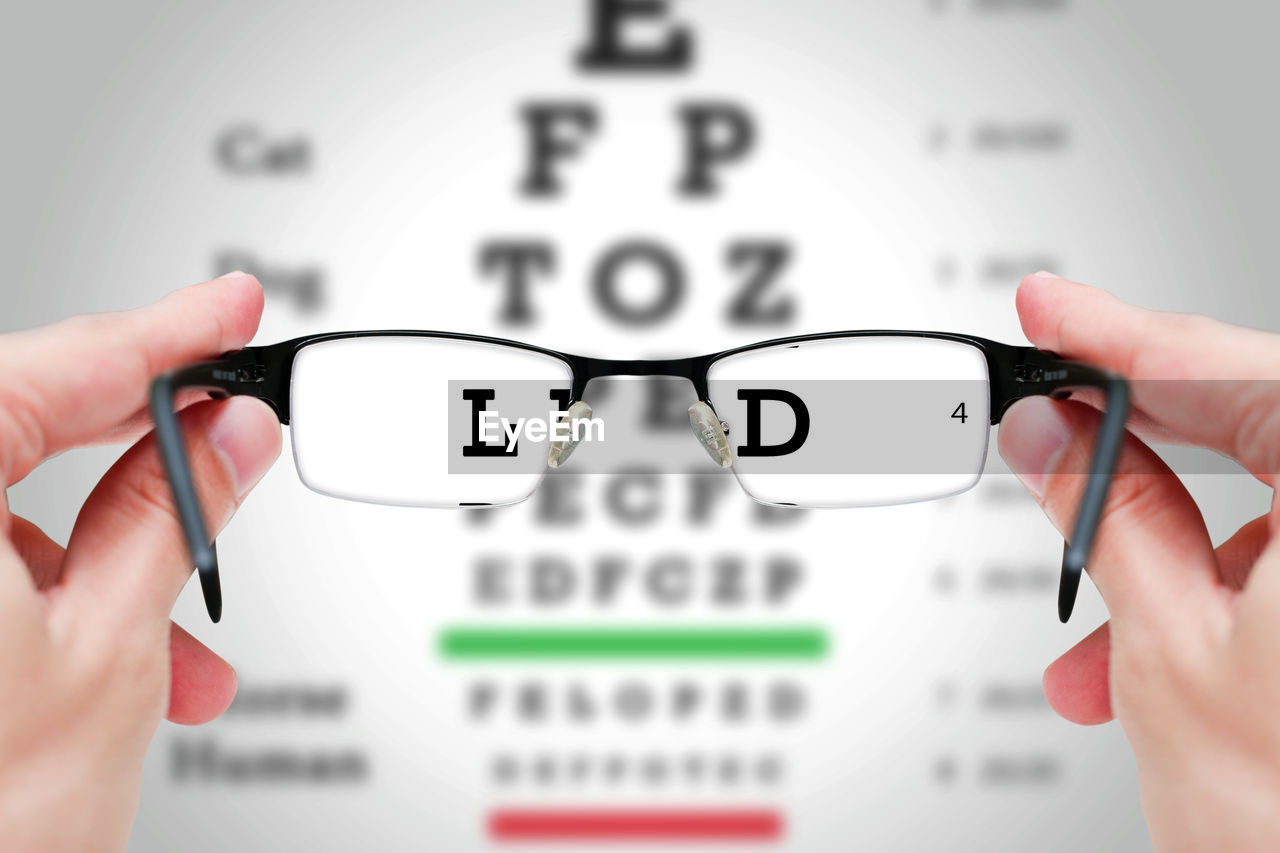 Text seen through eyeglasses held my person