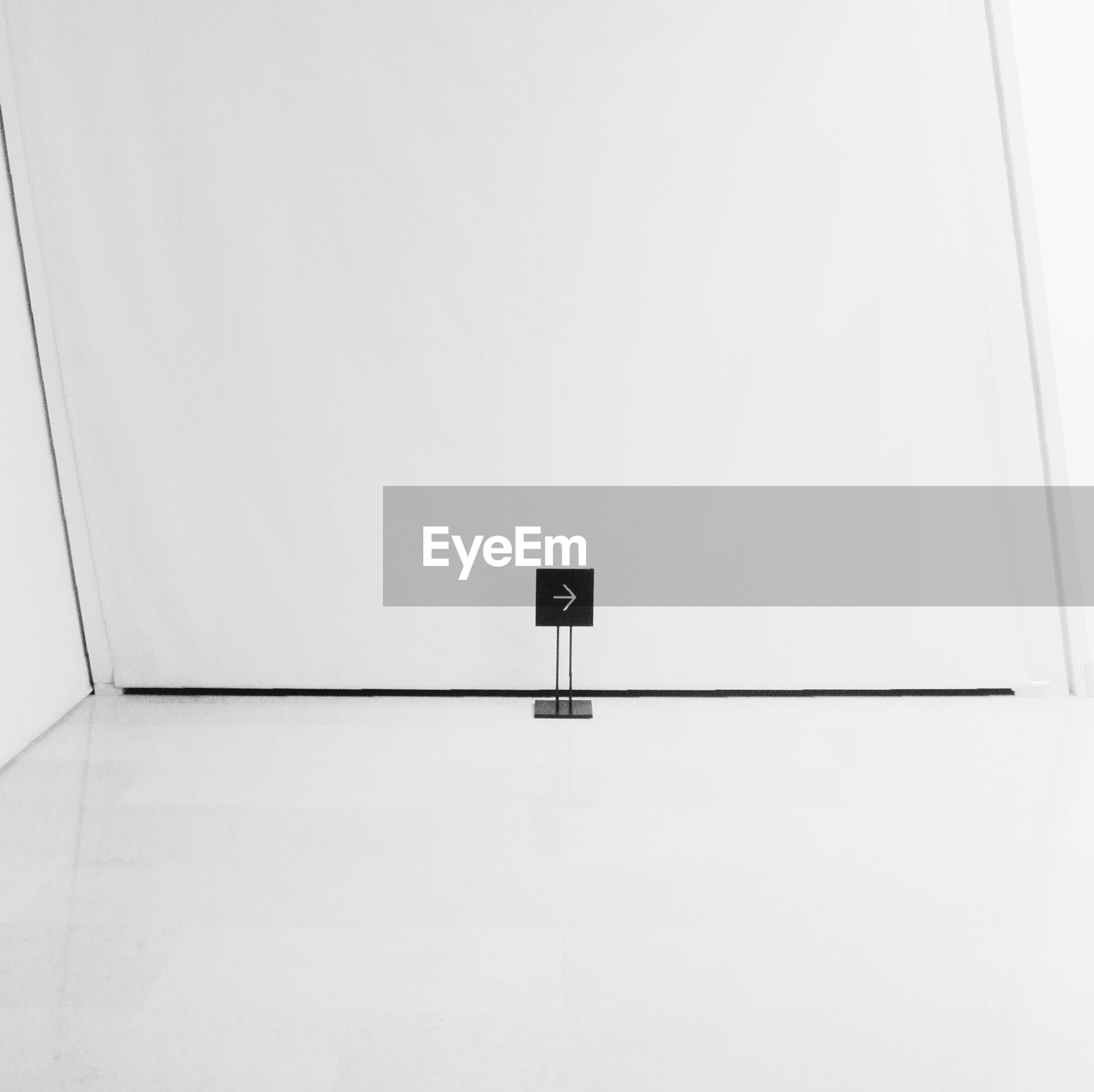 copy space, wall - building feature, indoors, white color, low angle view, architecture, built structure, wall, white, no people, clear sky, day, simplicity, close-up, geometric shape, technology, security, communication, safety, high section