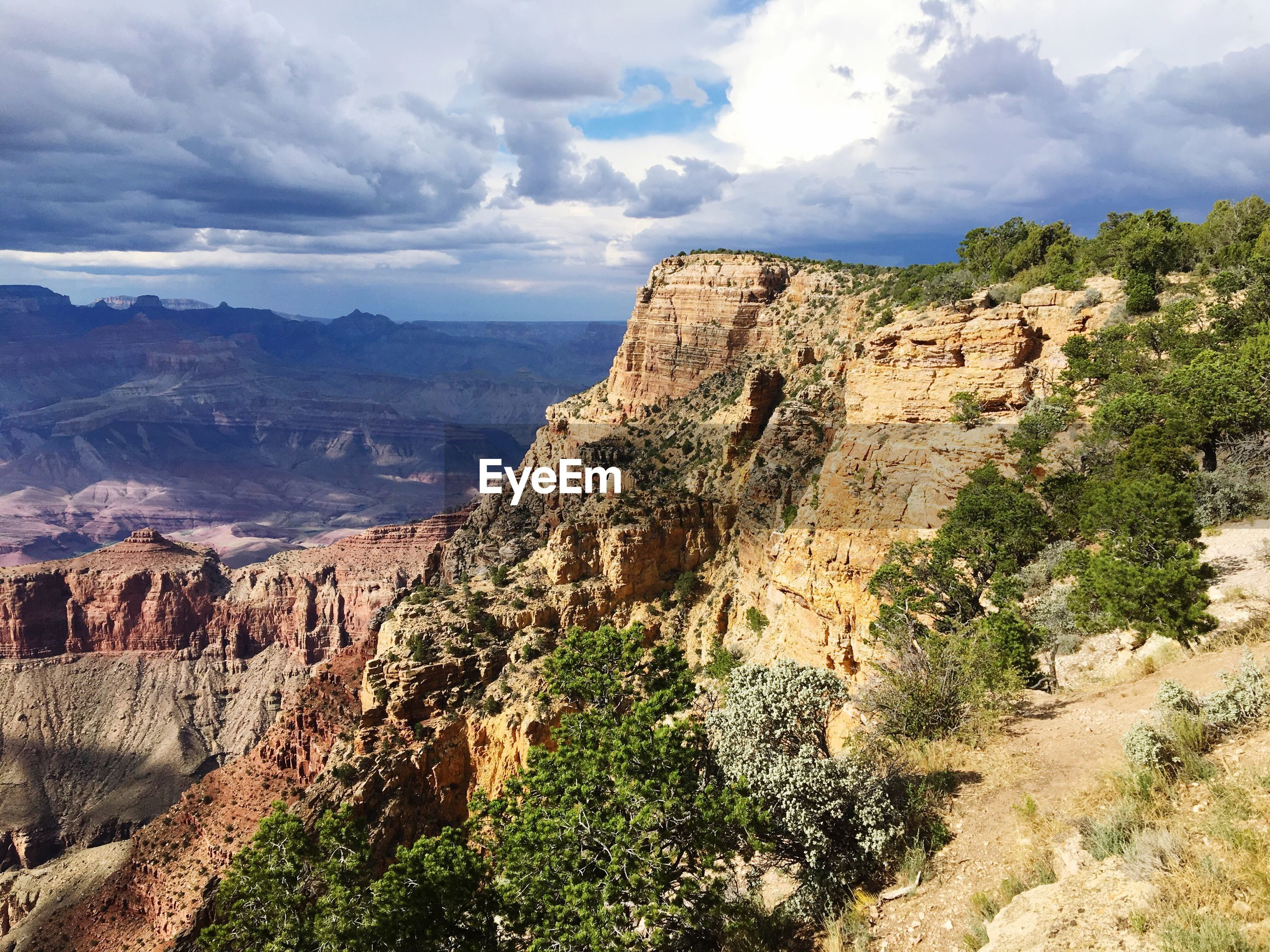 Scenic view of rock formations at grand canyon against sky