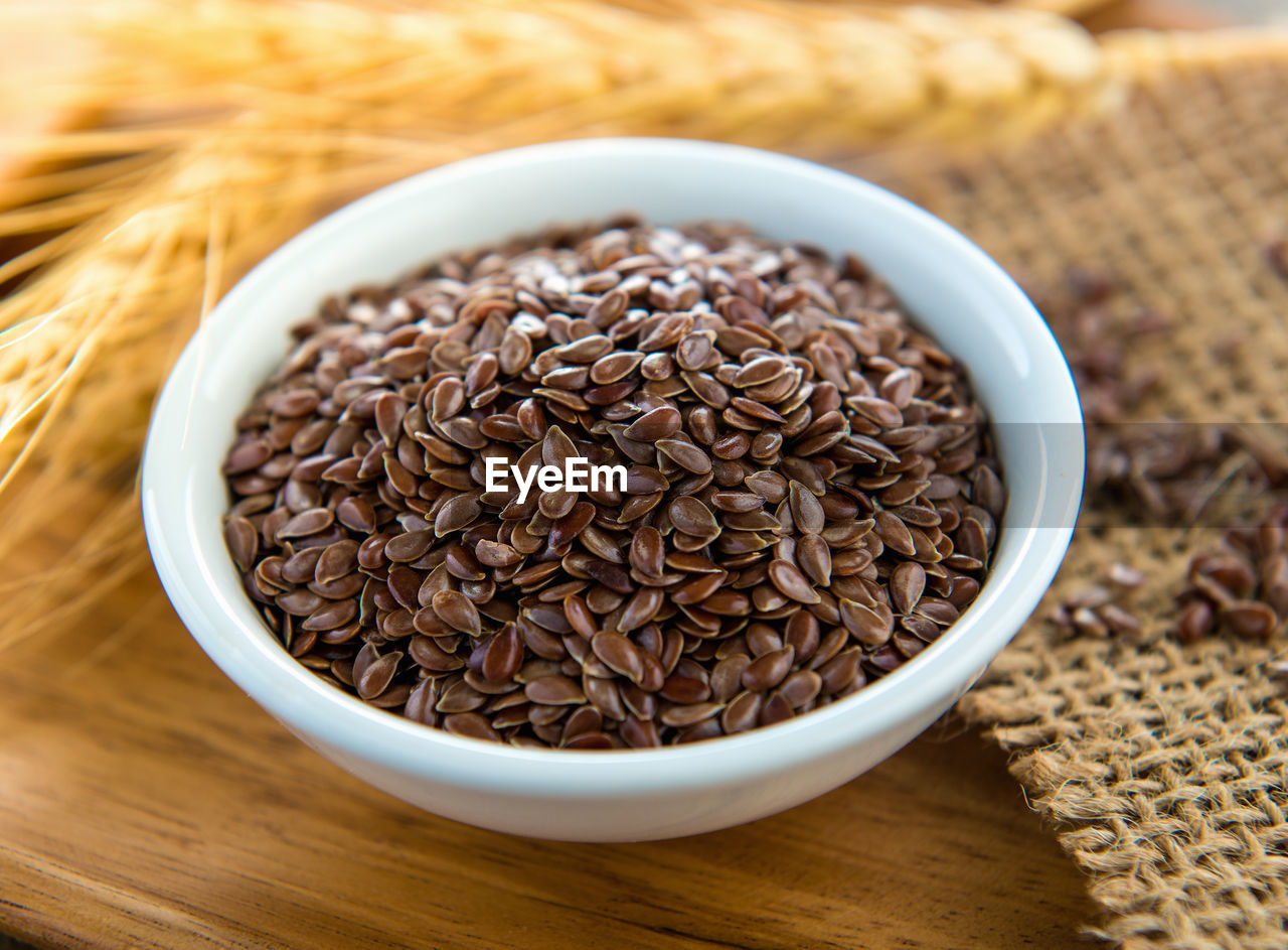 food and drink, table, freshness, food, still life, brown, wellbeing, indoors, close-up, healthy eating, no people, large group of objects, raw food, high angle view, seed, focus on foreground, container, bowl, selective focus, wood - material