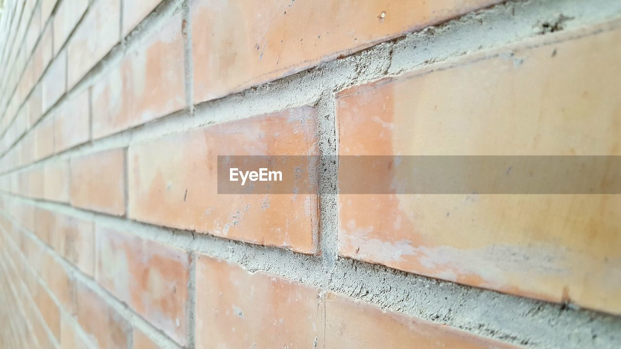 brick, brick wall, wall, architecture, wall - building feature, no people, built structure, pattern, day, close-up, textured, outdoors, selective focus, brown, full frame, backgrounds, focus on foreground, tile, shape, design, silver colored