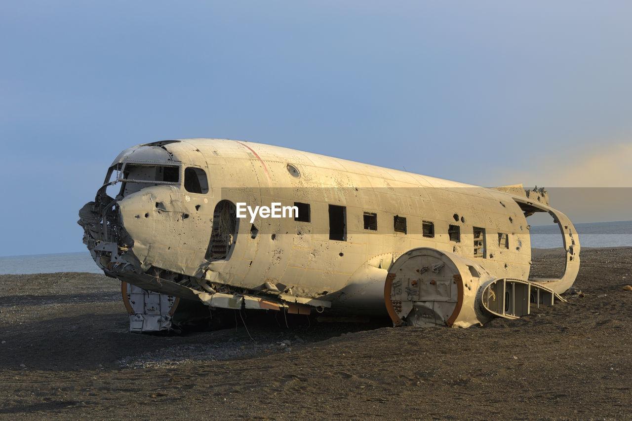 ABANDONED AIRPLANE ON SANDY BEACH
