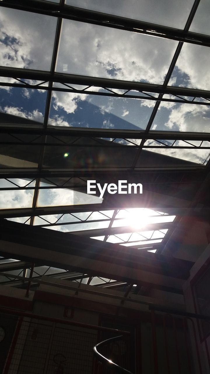 low angle view, sunbeam, sunlight, indoors, no people, cloud - sky, sky, sun, built structure, day, architecture, nature, close-up