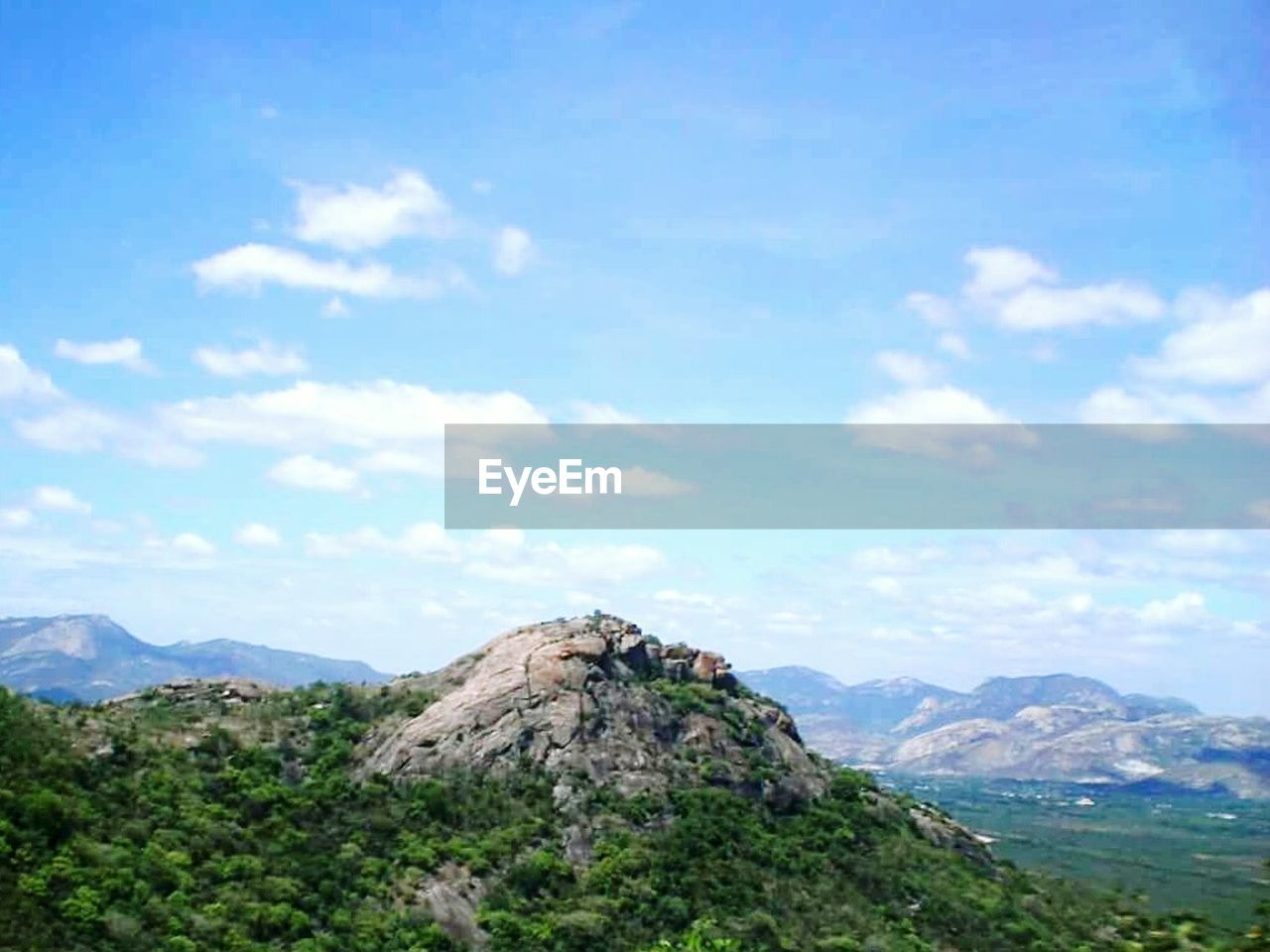 mountain, beauty in nature, scenics, sky, nature, tranquil scene, tranquility, day, cloud - sky, mountain range, landscape, outdoors, non-urban scene, rock - object, no people, physical geography, tree, blue