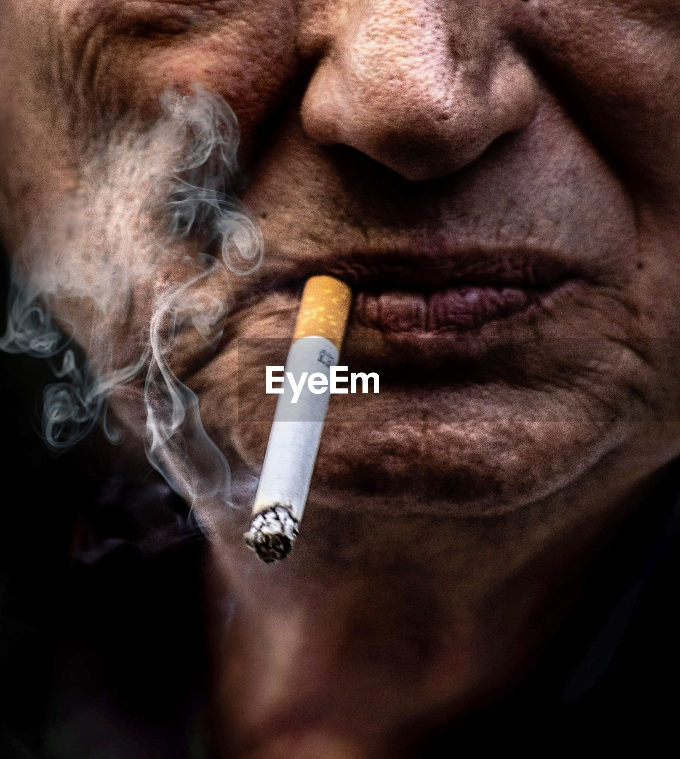 smoking issues, cigarette, social issues, smoking - activity, smoke - physical structure, bad habit, sign, activity, warning sign, tobacco product, one person, communication, close-up, risk, adult, human body part, men, narcotic, body part, human face, poisonous