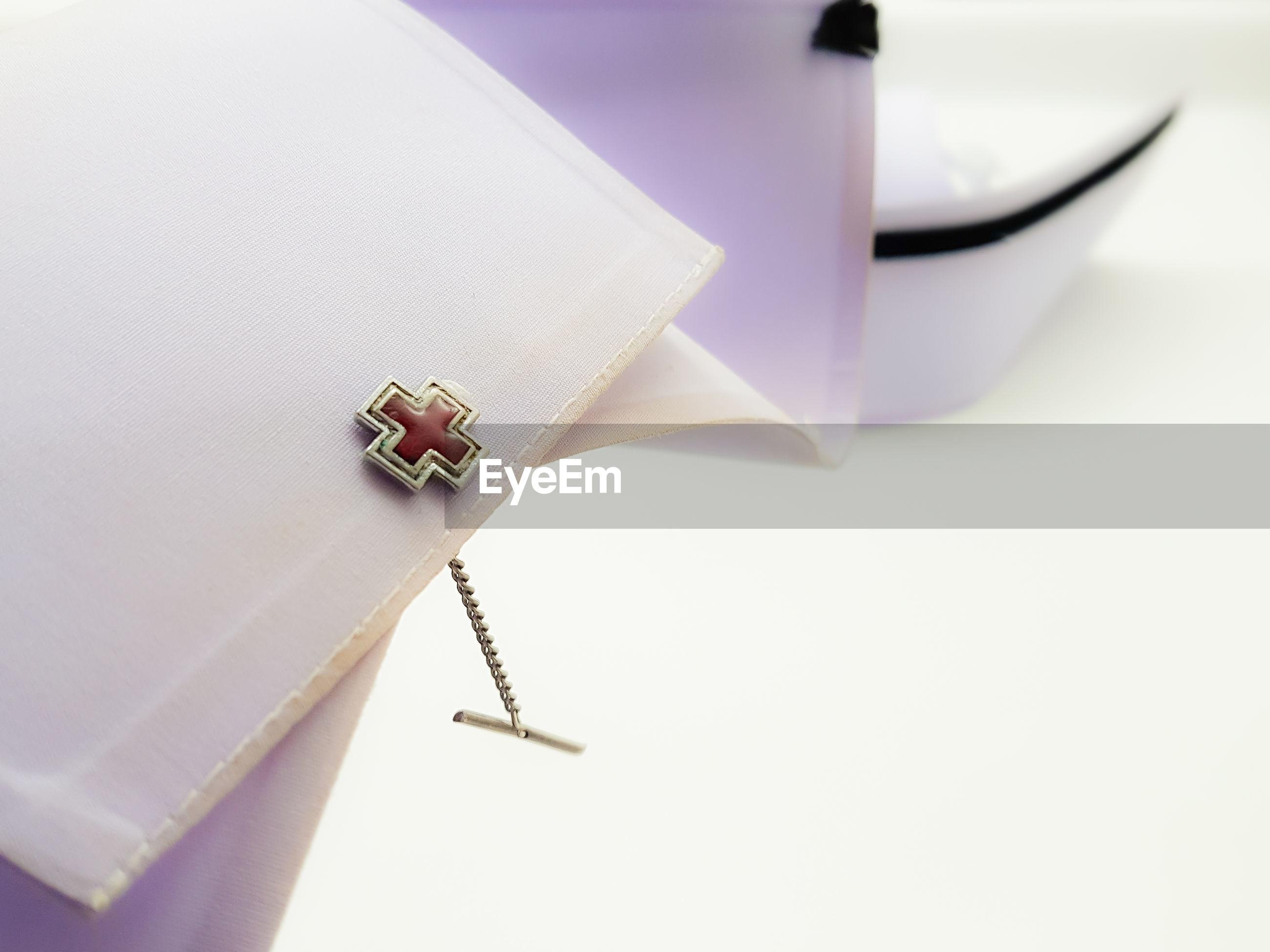 High angle view of cross shape on fabric