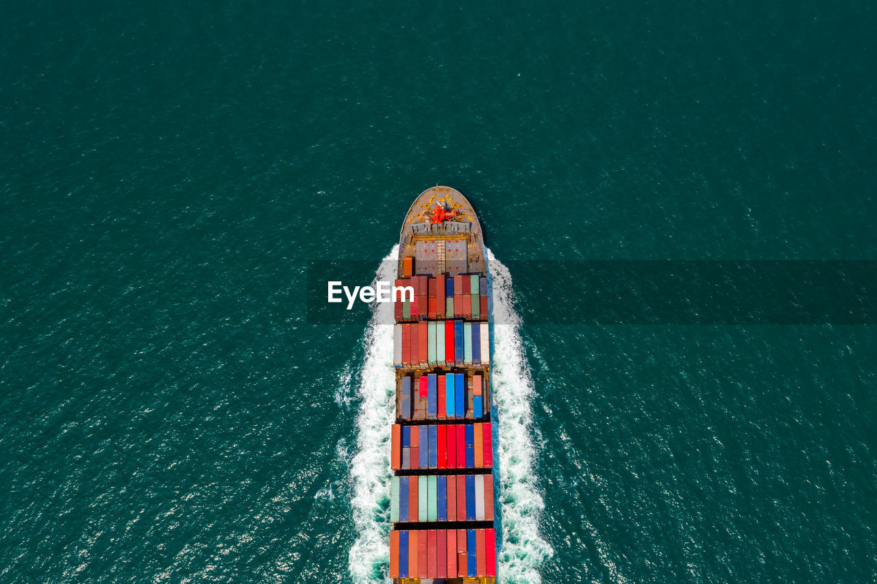 Aerial top view container cargo ship and import export business commercial logistic transportation