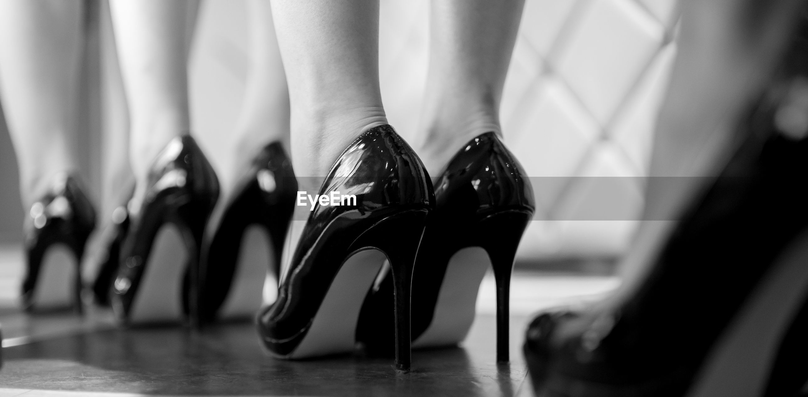 Low section of models in stilettos at backstage