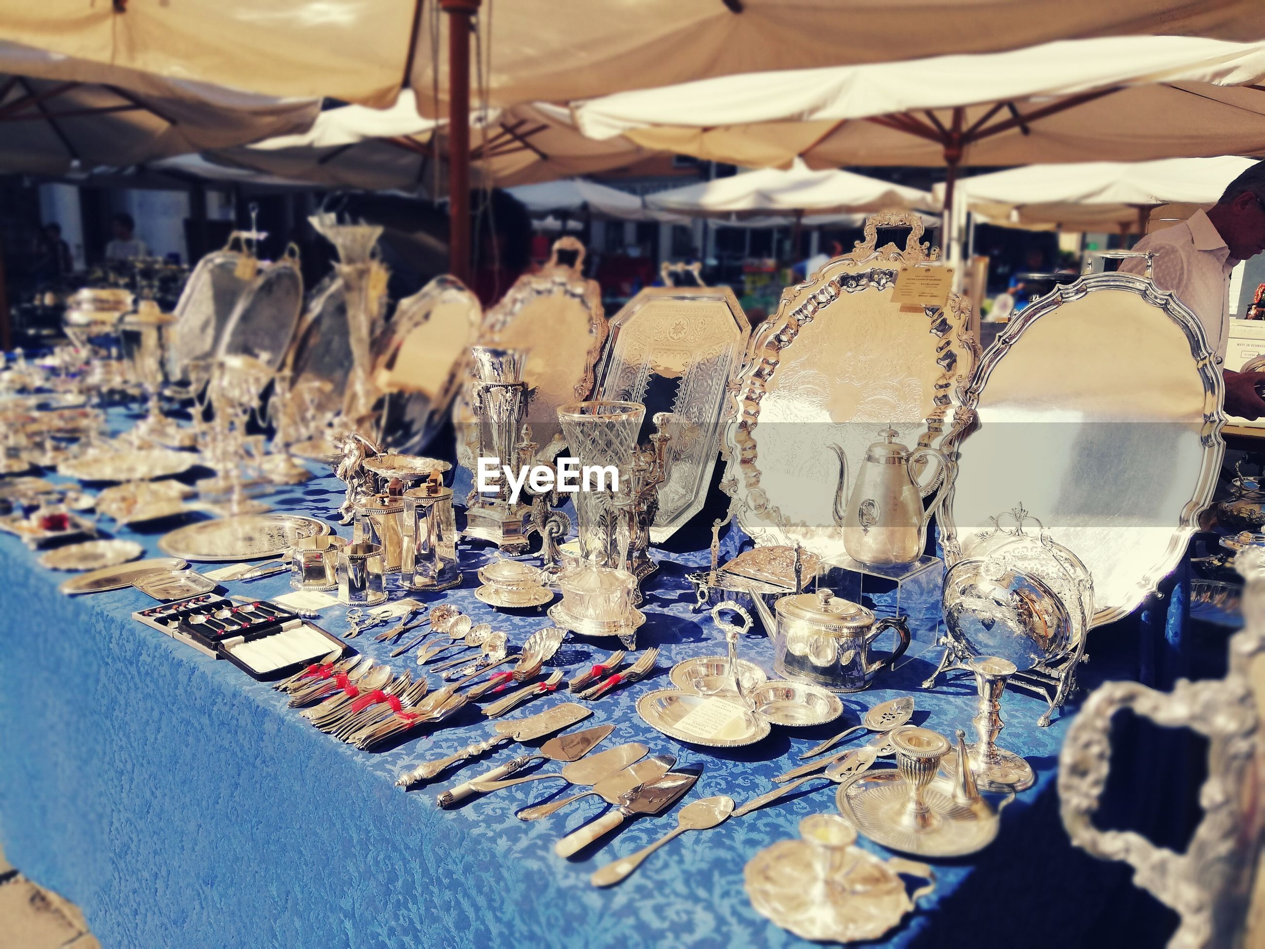 High angle view of kitchen utensils arranged on table for sale in market