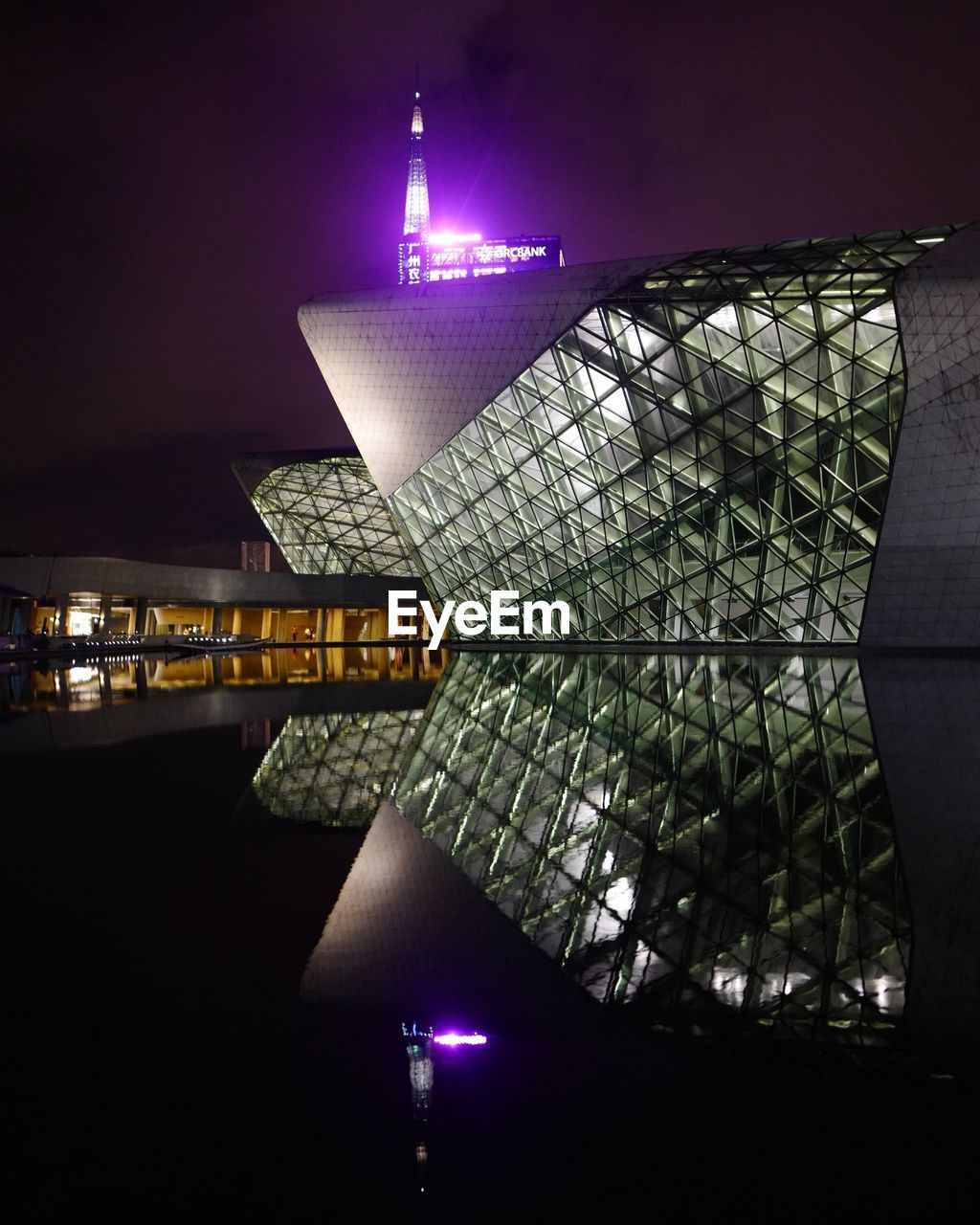 night, illuminated, architecture, built structure, building exterior, reflection, water, city, no people, building, lighting equipment, travel destinations, nature, modern, sky, travel, tourism, outdoors, light, skyscraper, office building exterior