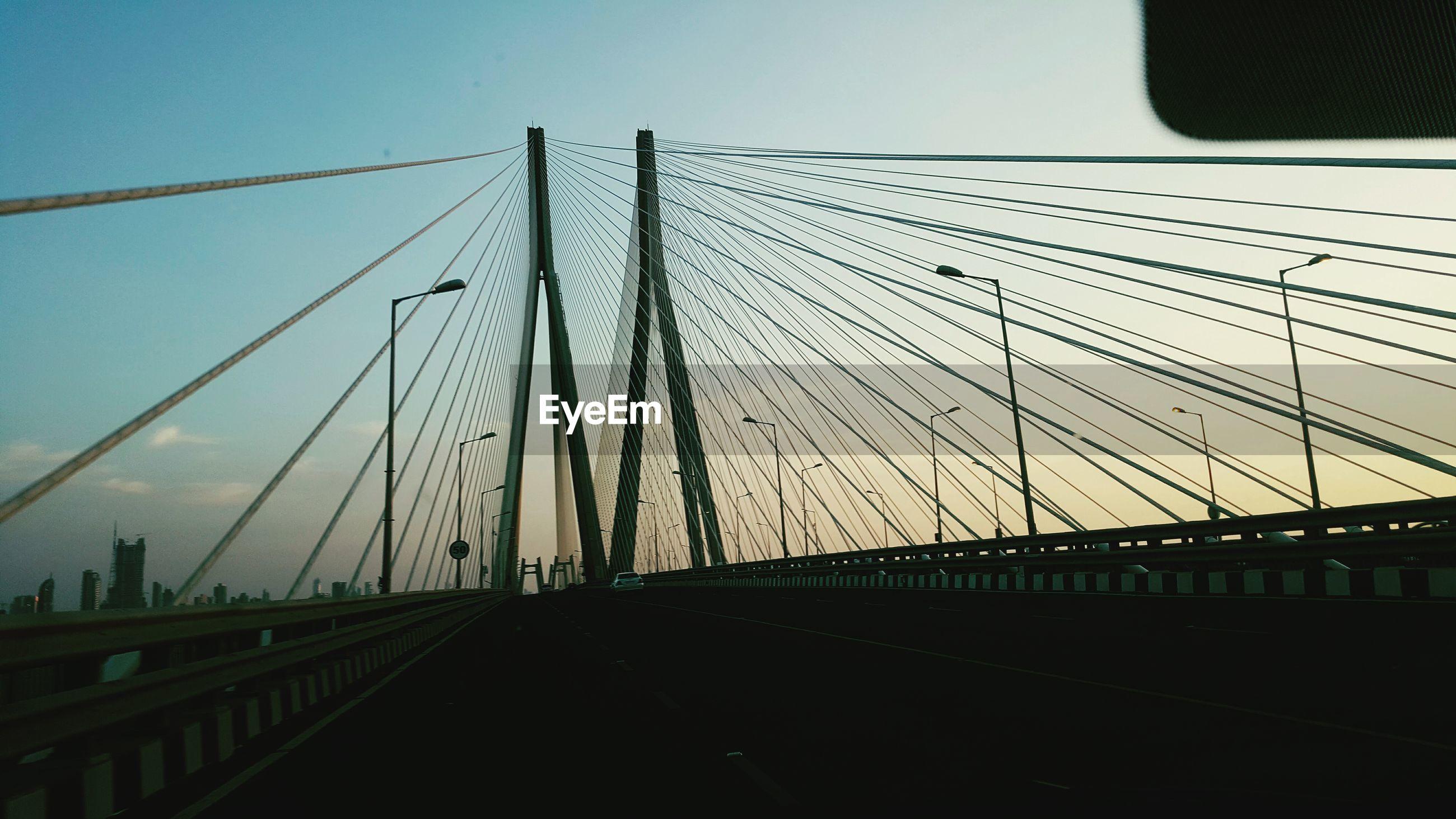 Bandraworli sea link against sky seen through car windshield