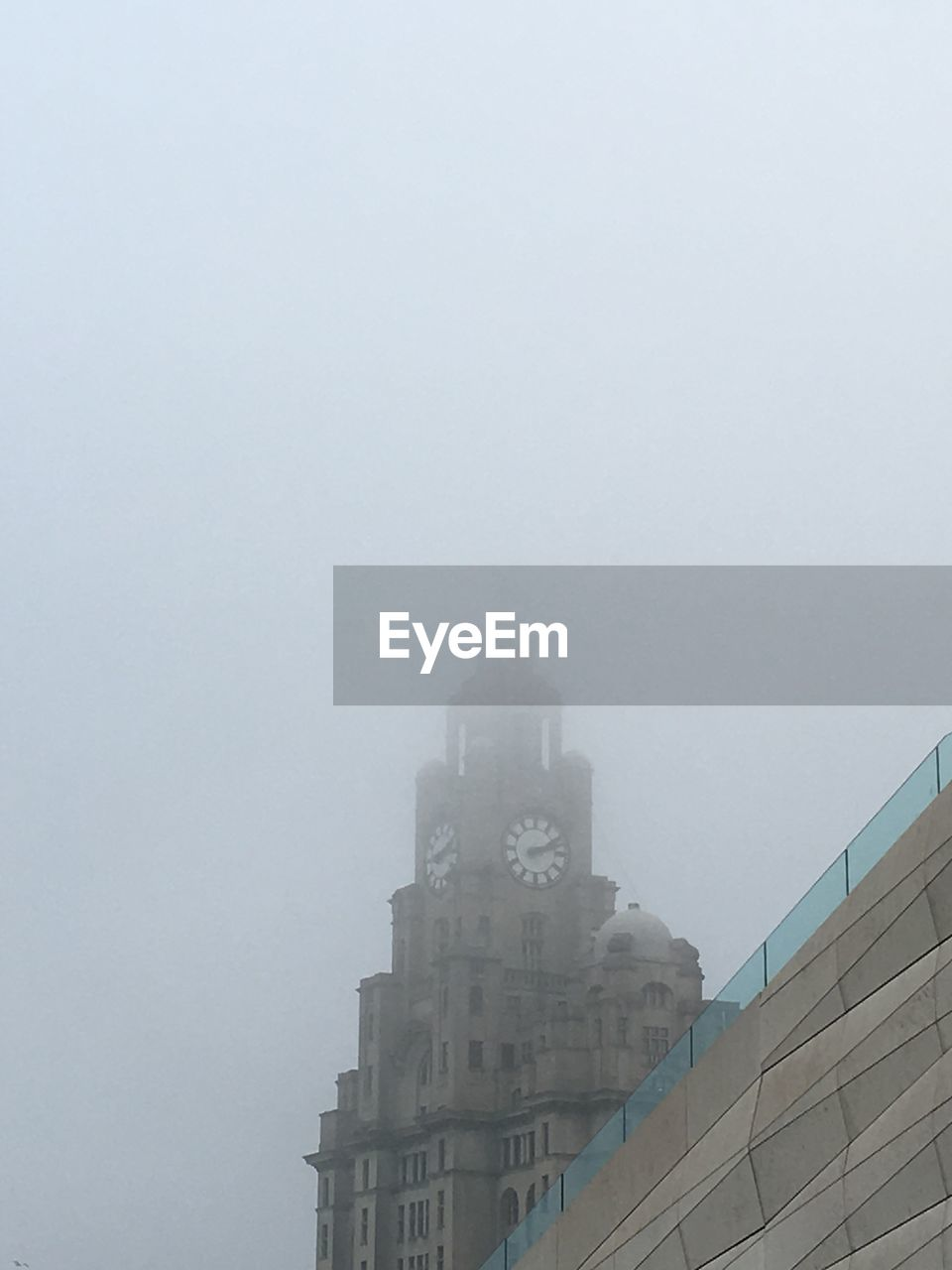 fog, copy space, architecture, building exterior, built structure, outdoors, no people, low angle view, day, skyscraper, city, sky, nature