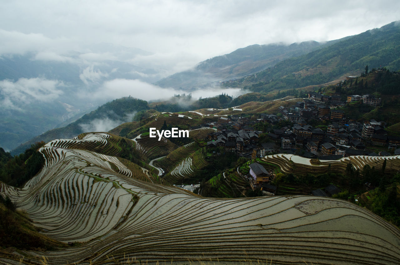 Scenic View Of Rice Paddy Mountains Against Sky