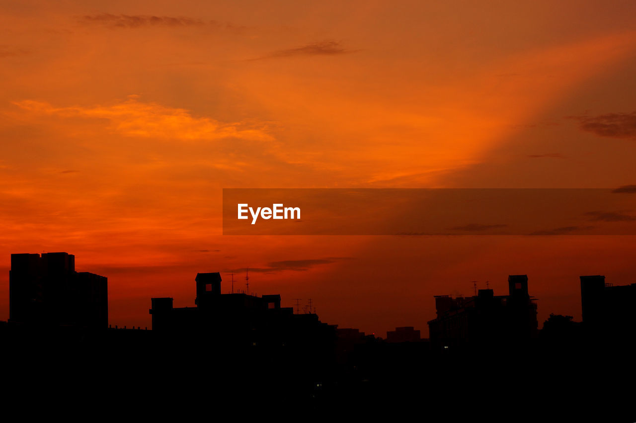 sunset, orange color, silhouette, architecture, skyscraper, building exterior, city, no people, built structure, sky, modern, cityscape, outdoors, beauty in nature, nature, urban skyline