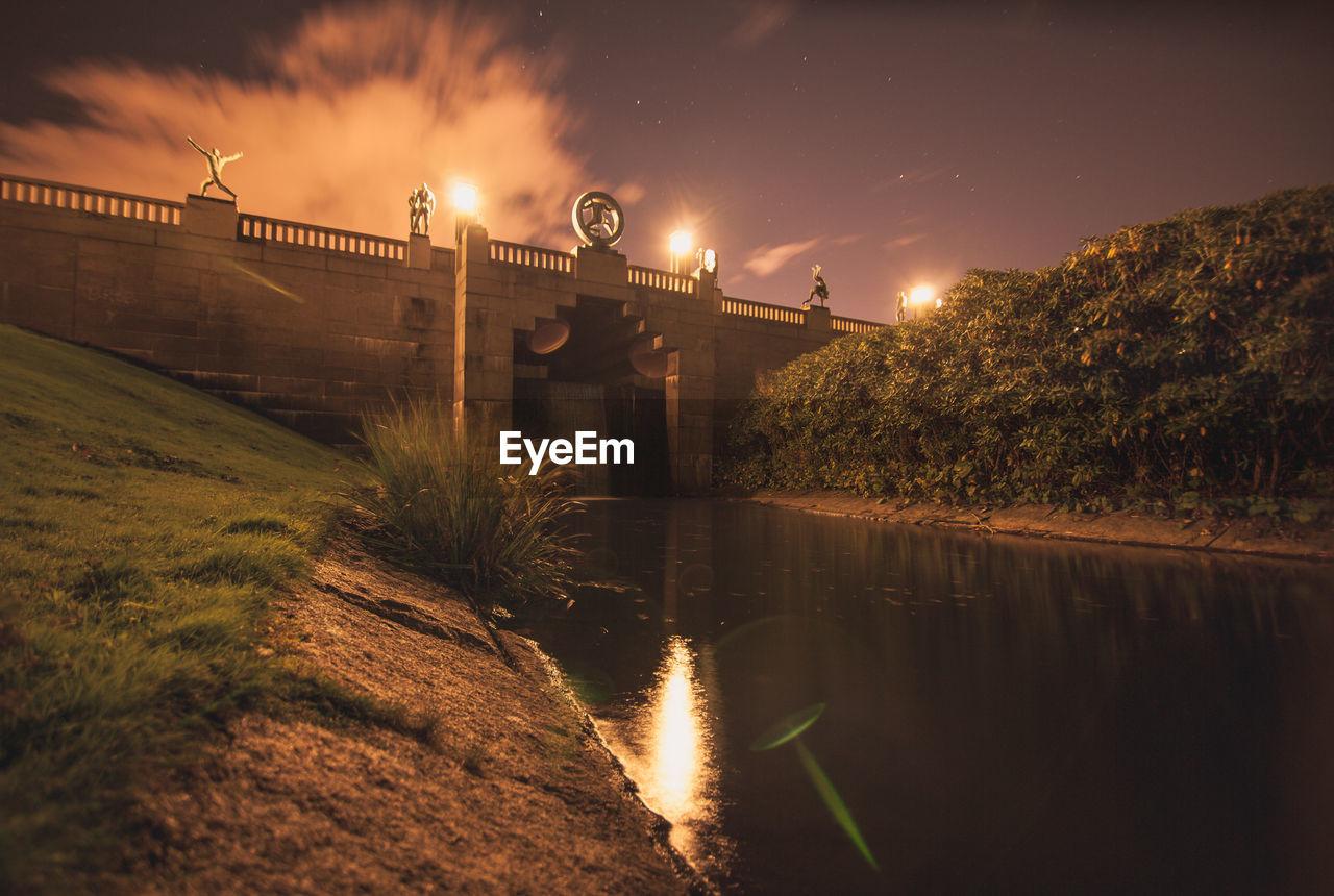 Bridge In Vigeland Sculpture Park Against Sky At Night