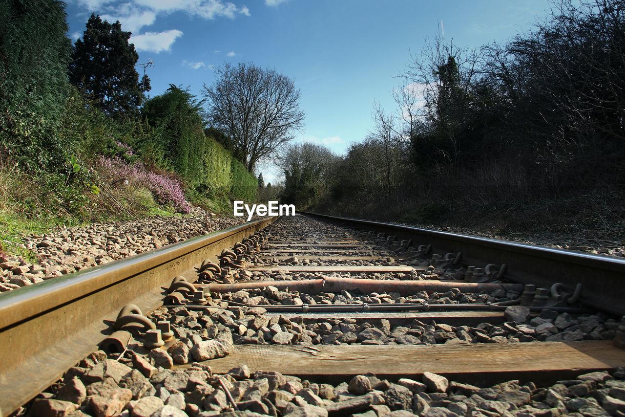 railroad track, transportation, rail transportation, railroad tie, metal, tree, day, railway track, outdoors, no people, the way forward, rock - object, sky, nature, railroad, landscape, beauty in nature