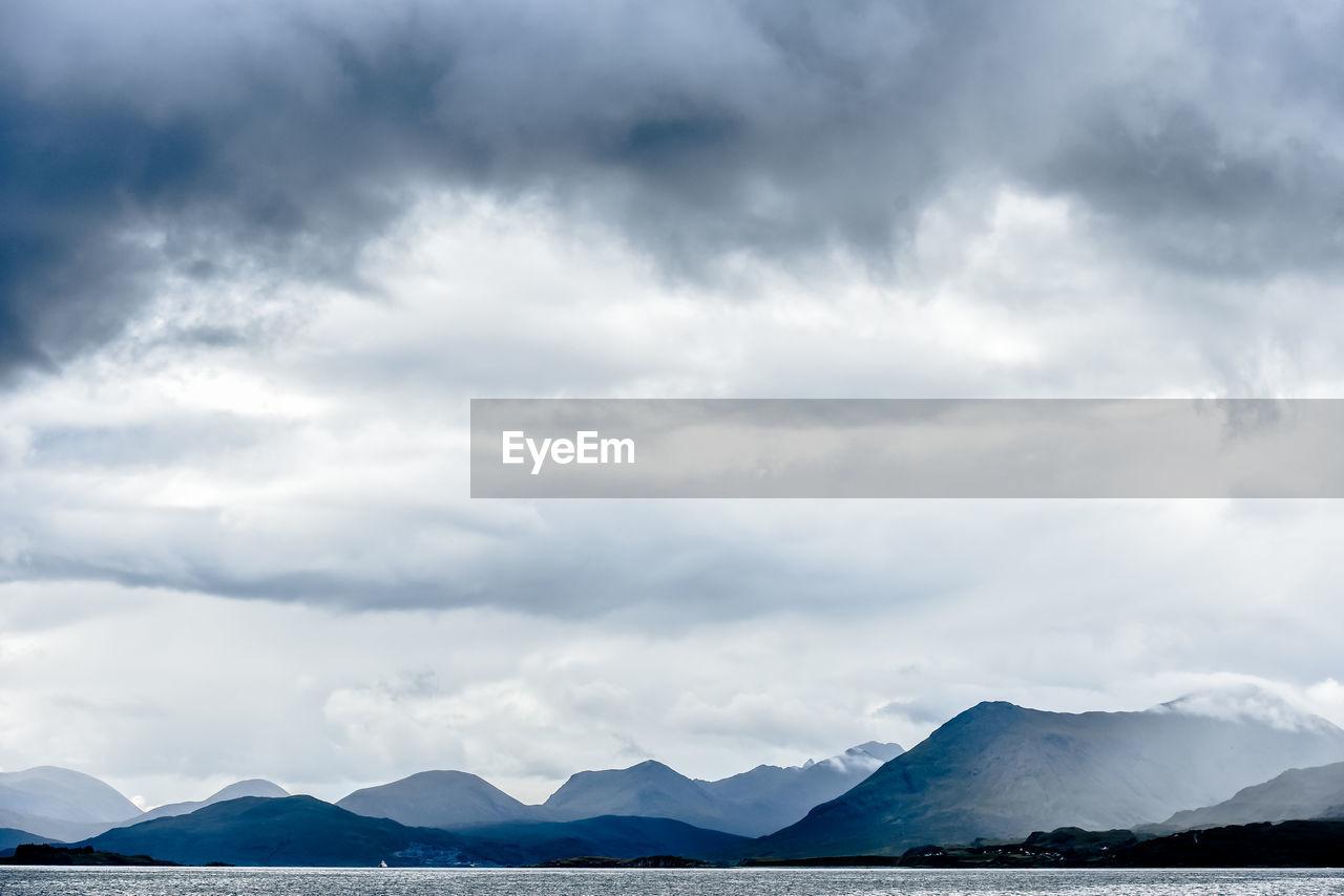 cloud - sky, sky, mountain, beauty in nature, scenics - nature, tranquil scene, tranquility, day, nature, no people, water, non-urban scene, outdoors, environment, overcast, lake, idyllic, mountain range