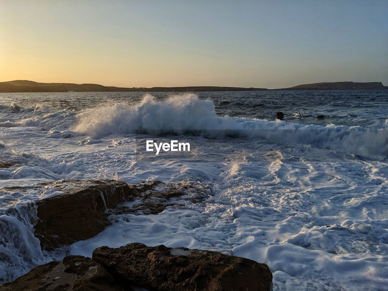 water, beauty in nature, scenics - nature, motion, sky, sea, sport, nature, rock, aquatic sport, no people, power in nature, rock - object, wave, solid, sunset, clear sky, power, horizon over water, outdoors, flowing water
