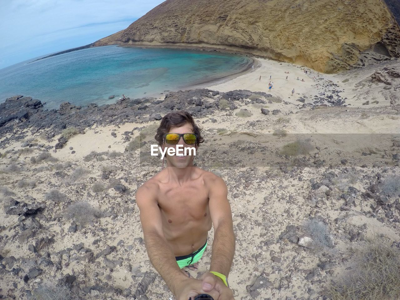 Man taking selfie with monopod at beach