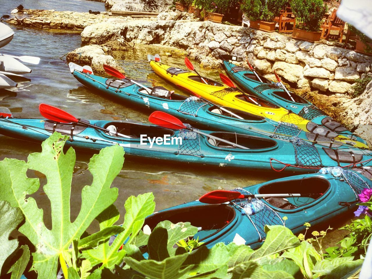 High Angle View Of Kayaks At Beach