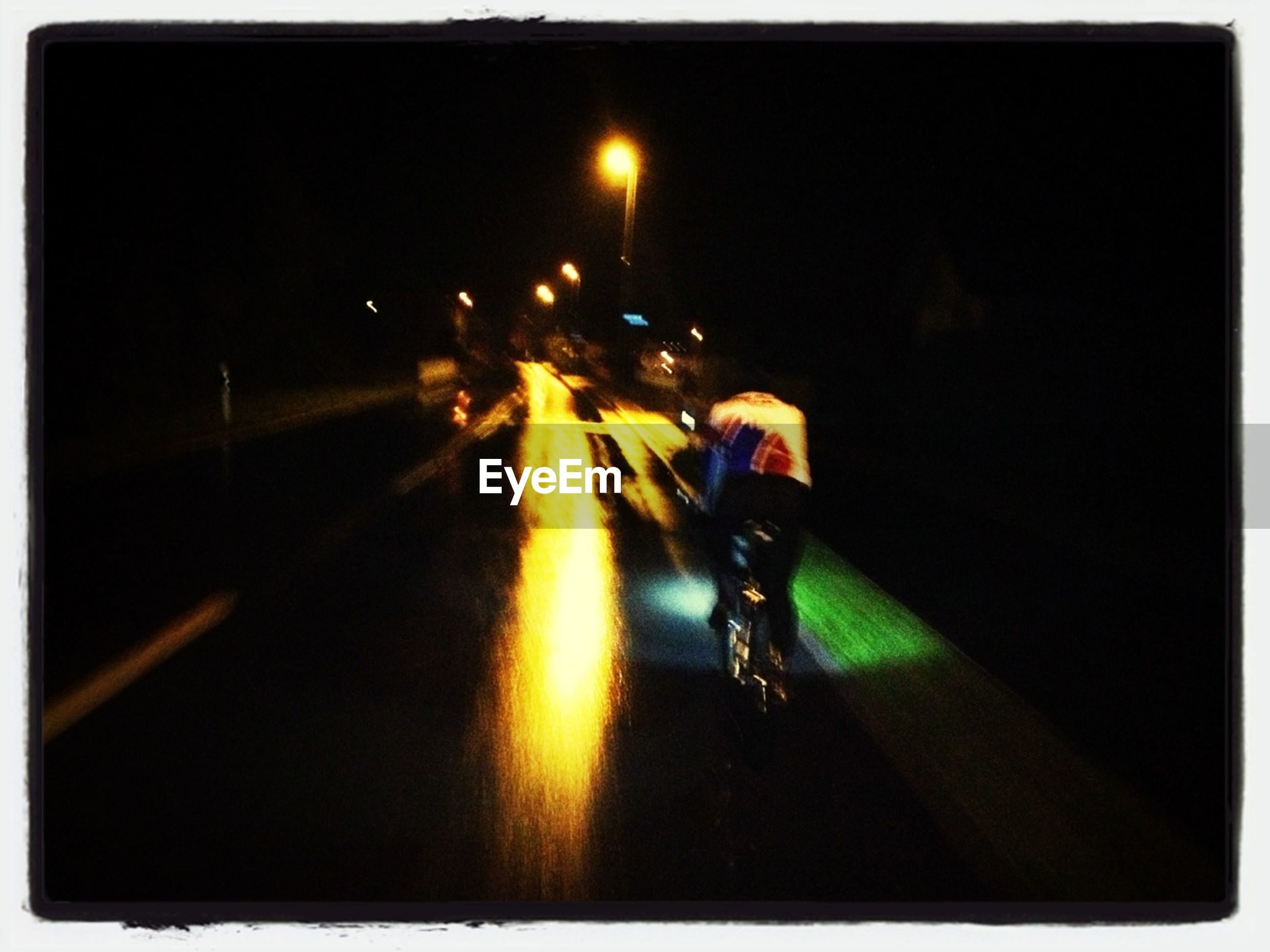 transfer print, transportation, night, land vehicle, mode of transport, illuminated, auto post production filter, street, men, road, car, lifestyles, on the move, bicycle, unrecognizable person, walking, dark, full length