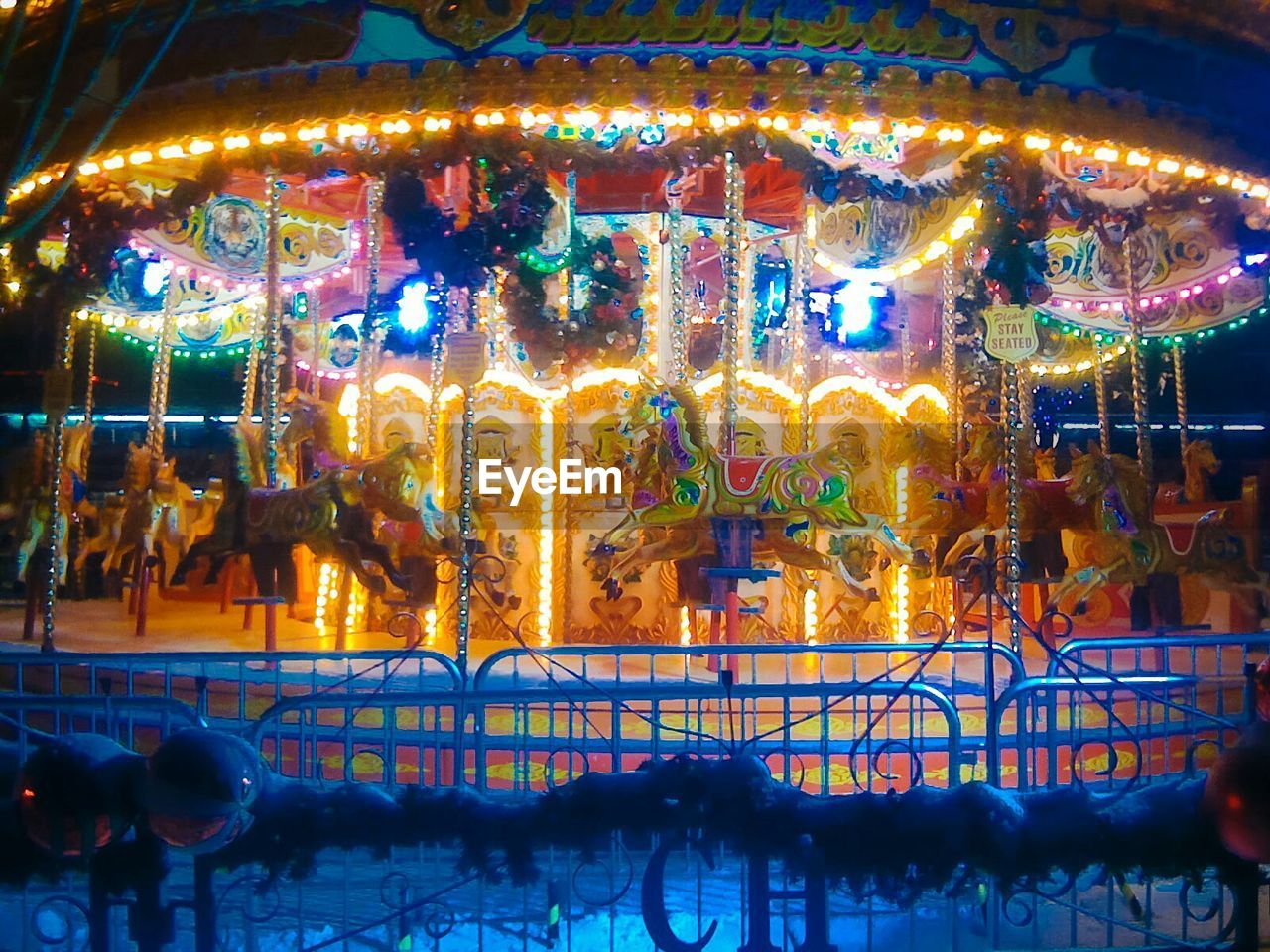 illuminated, amusement park, night, arts culture and entertainment, carousel, no people, outdoors, multi colored, amusement park ride, close-up