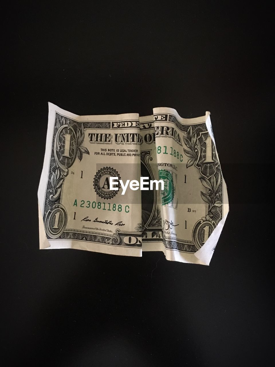 Close-up of paper currency against black background