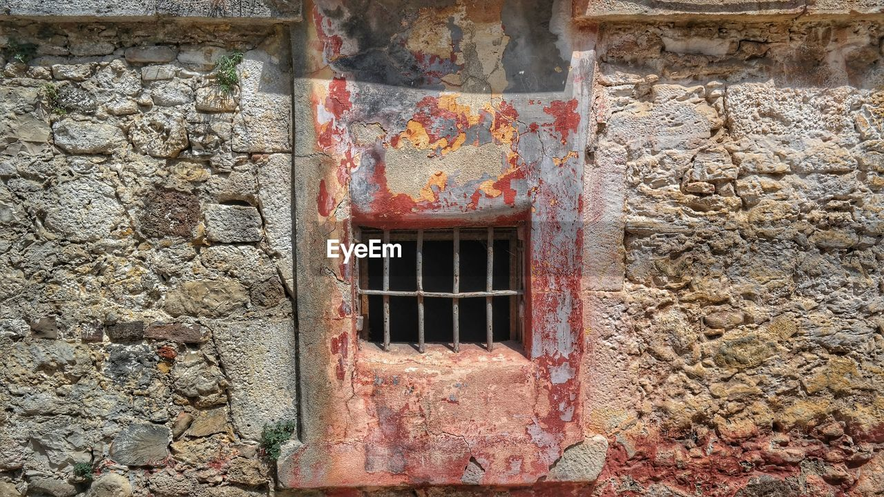 built structure, architecture, window, building exterior, old, wall - building feature, weathered, wall, day, no people, building, metal, rusty, damaged, stone wall, abandoned, decline, deterioration, history, outdoors, brick