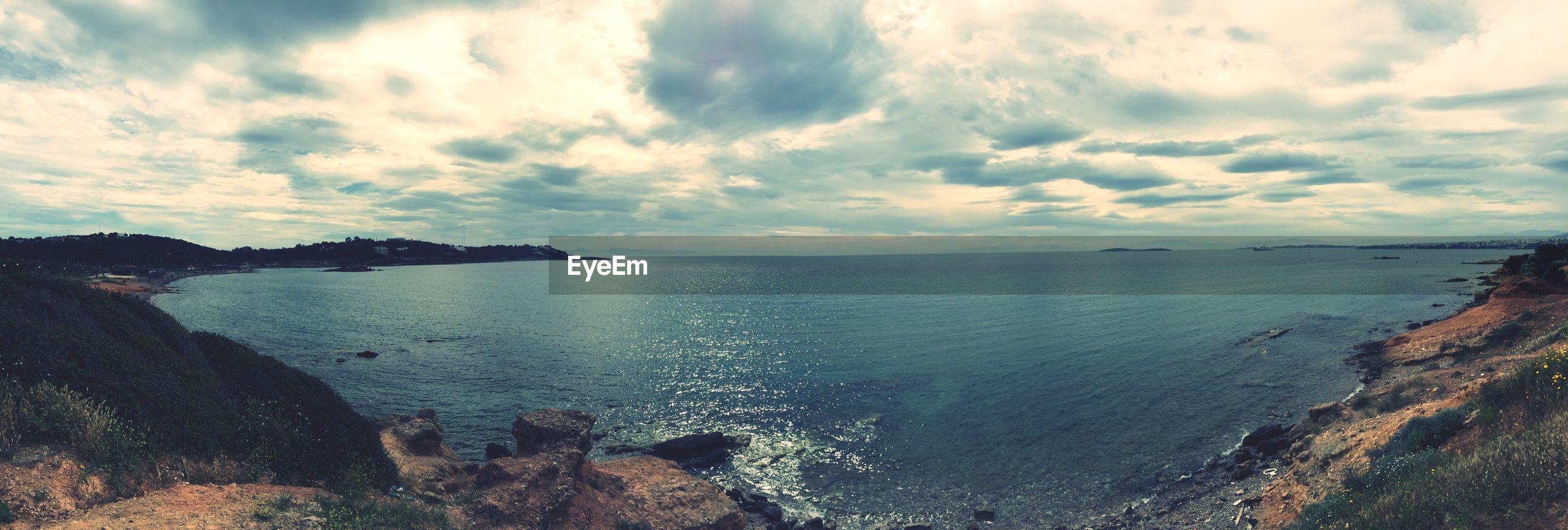 water, sea, sky, tranquil scene, horizon over water, tranquility, scenics, beauty in nature, cloud - sky, beach, shore, nature, cloudy, cloud, idyllic, reflection, coastline, calm, outdoors, non-urban scene