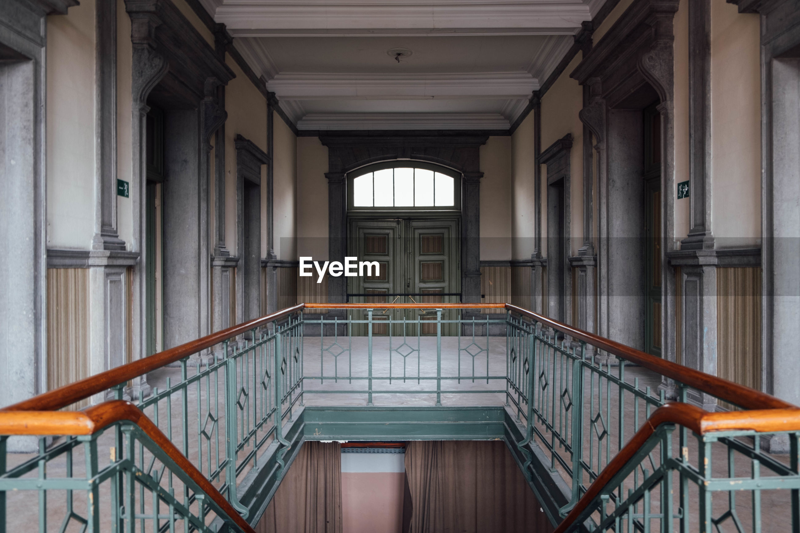 architecture, railing, staircase, indoors, built structure, day, no people, steps and staircases, building, window, absence, entrance, door, empty, metal, architectural column, the way forward, arcade, wood - material, ceiling