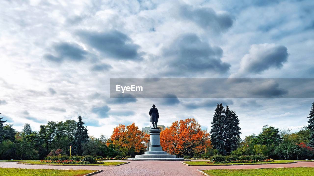 cloud - sky, tree, plant, sky, nature, autumn, day, statue, sculpture, human representation, art and craft, no people, representation, architecture, memorial, male likeness, outdoors, change, growth, beauty in nature