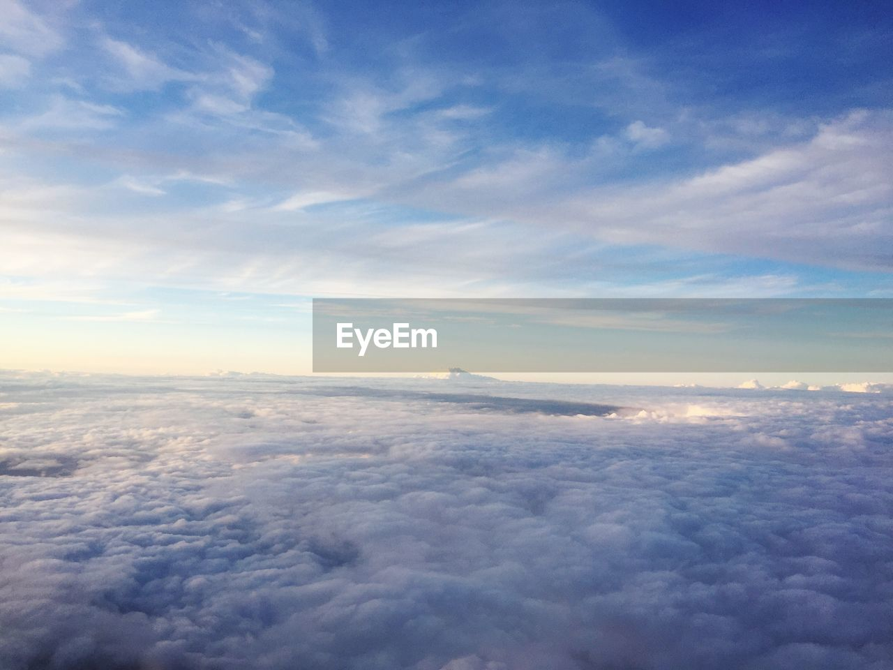 cloud - sky, sky, nature, beauty in nature, scenics, cloudscape, aerial view, tranquility, tranquil scene, majestic, blue, outdoors, no people, sky only, the natural world, above, day