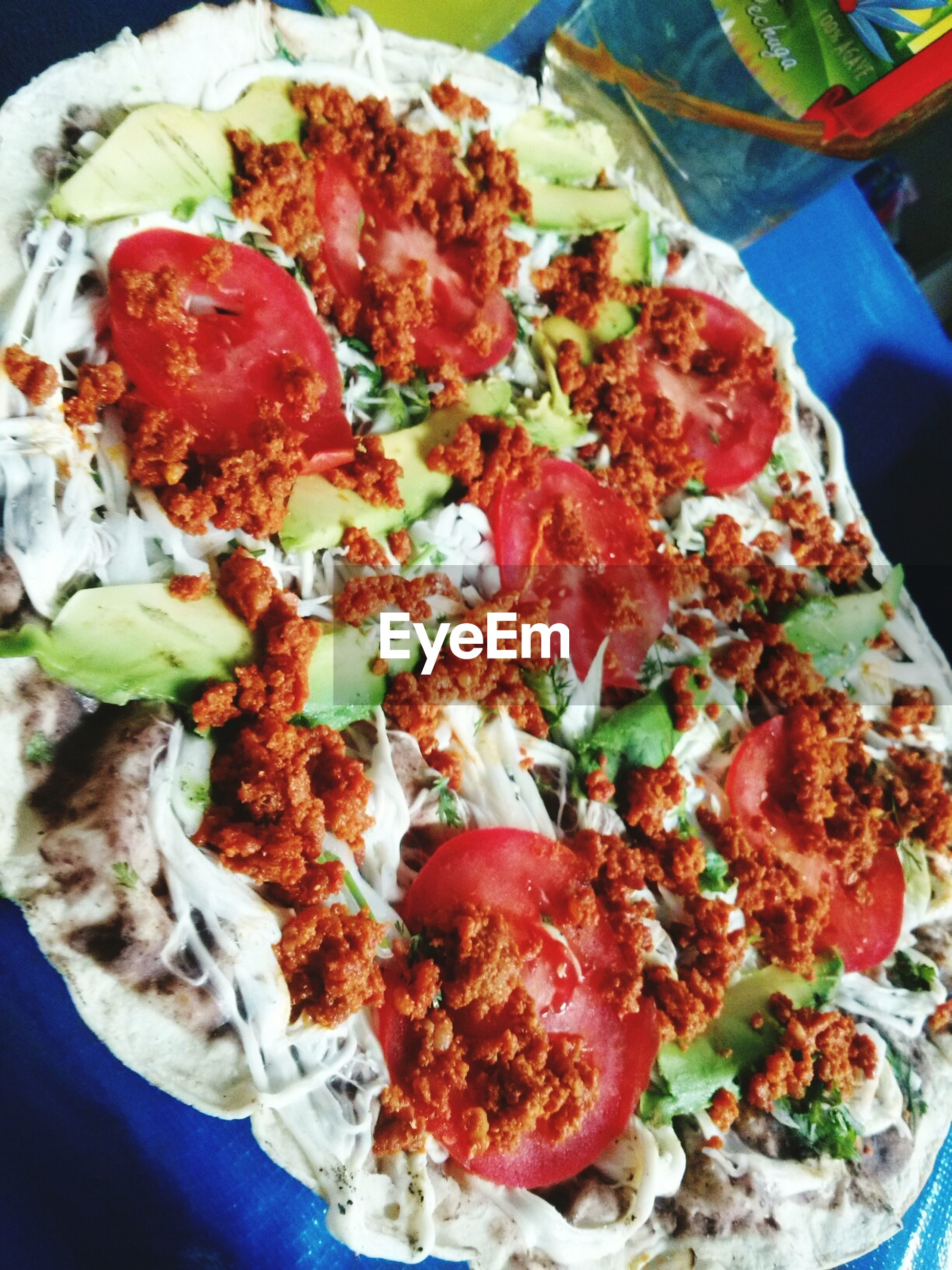 food, food and drink, freshness, indoors, ready-to-eat, healthy eating, still life, pizza, close-up, plate, serving size, meal, indulgence, tomato, salad, vegetable, meat, slice, cheese, high angle view