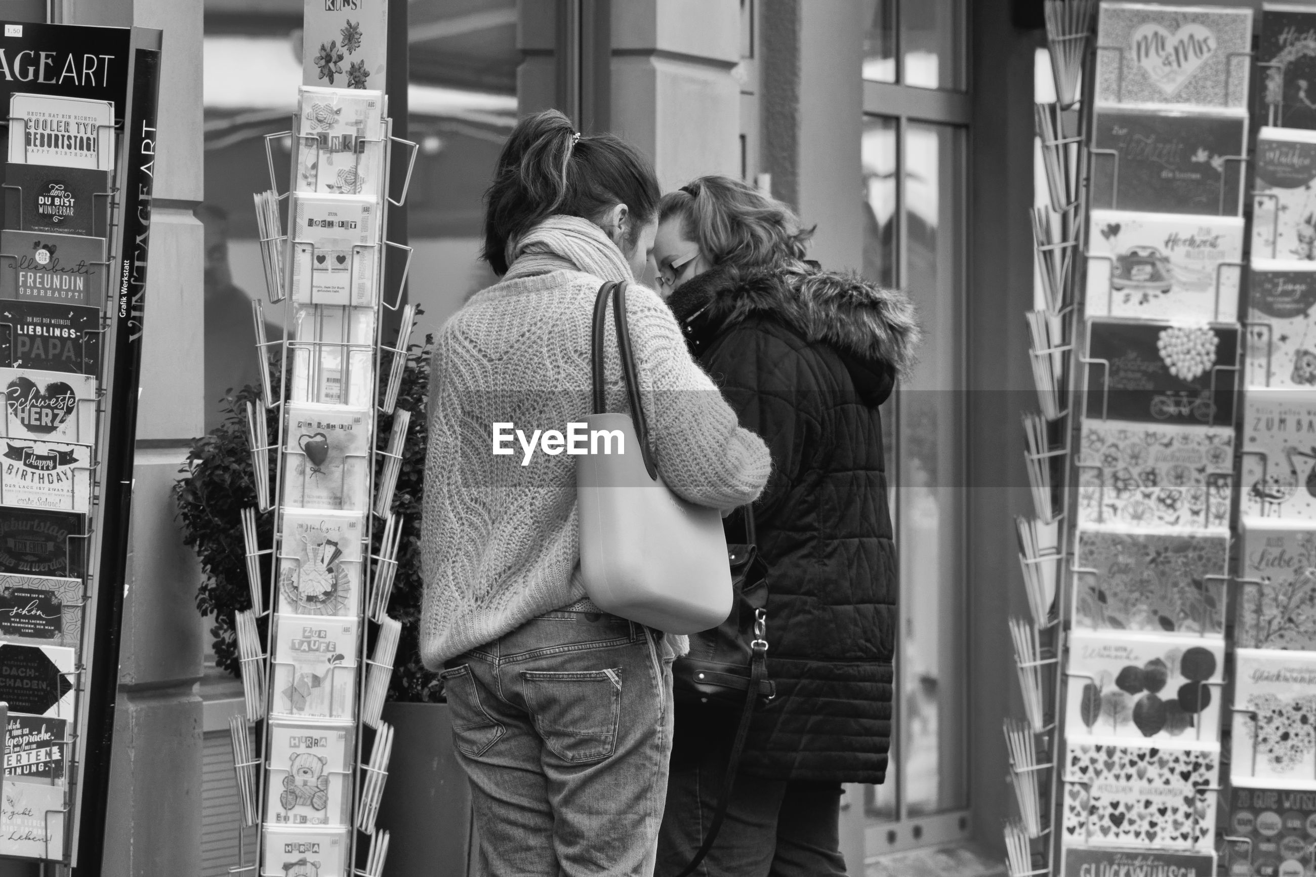 REAR VIEW OF COUPLE STANDING IN FRONT