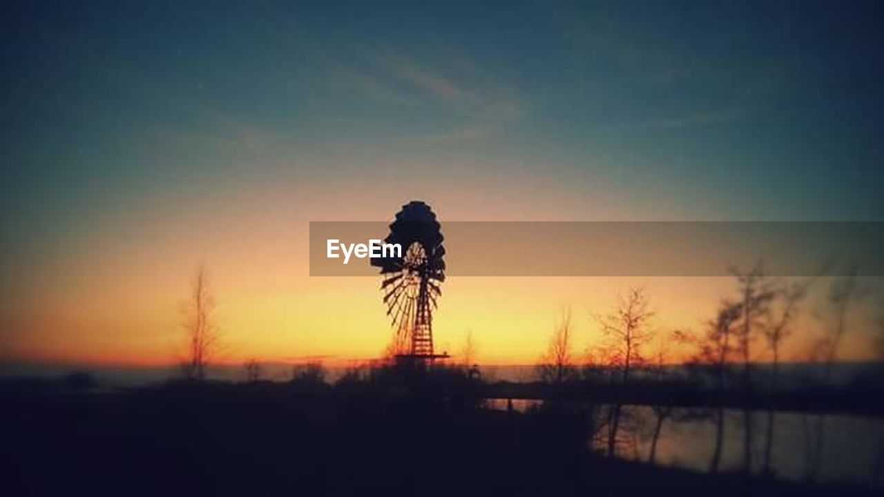 sunset, silhouette, nature, beauty in nature, no people, outdoors, sky, tranquility, scenics, water, clear sky, windmill, traditional windmill, architecture, day
