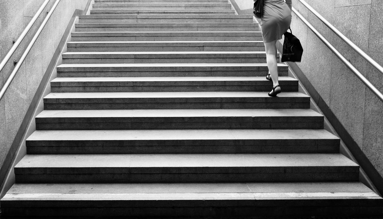 Low Section Of Woman Walking On Steps