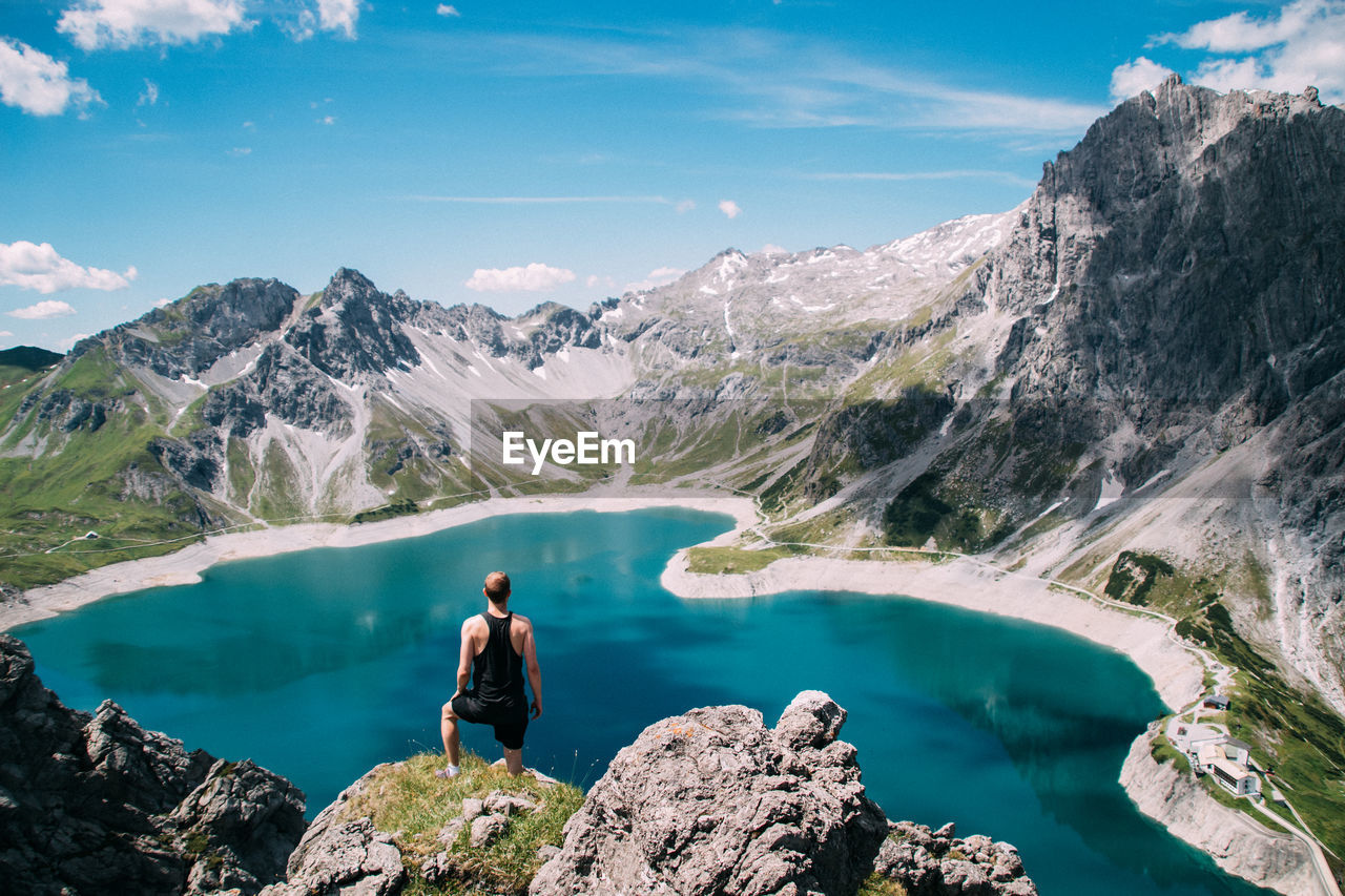 High Angle View Of Man Standing On Cliff Against Lunersee