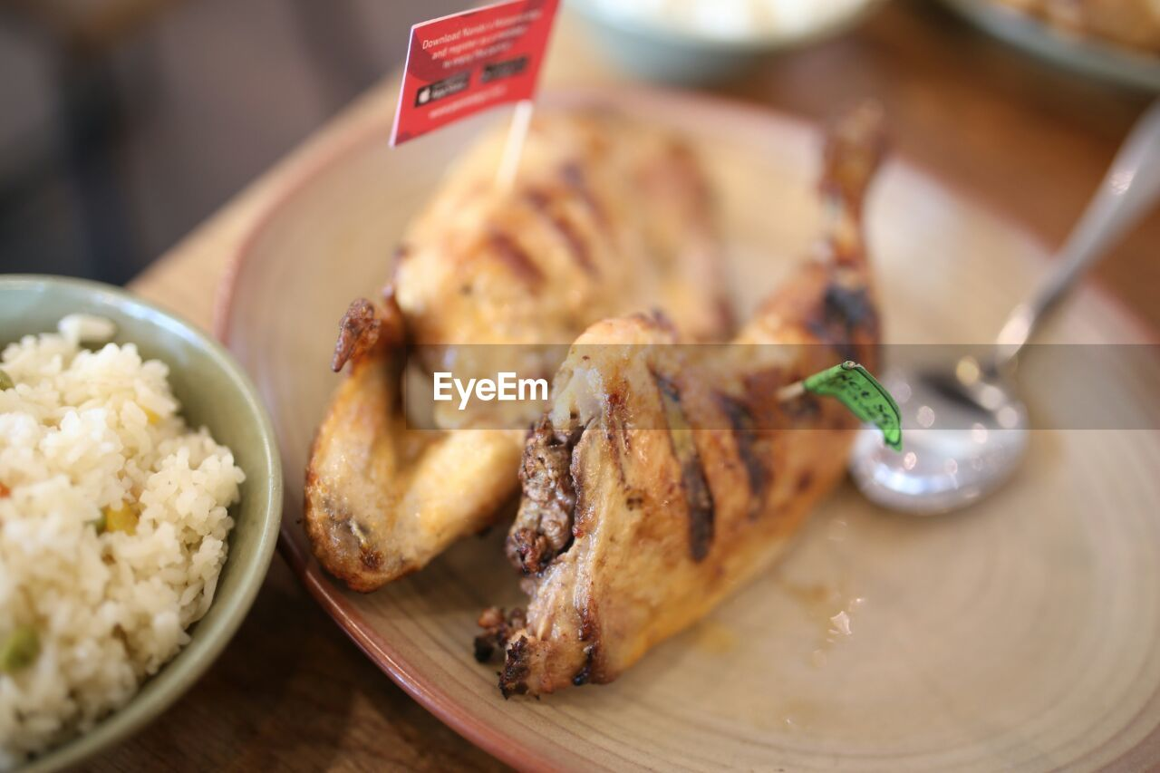 food and drink, food, freshness, indoors, close-up, ready-to-eat, still life, table, wellbeing, meat, plate, no people, focus on foreground, selective focus, wood - material, healthy eating, serving size, indulgence, meal, chicken, snack, temptation, white meat