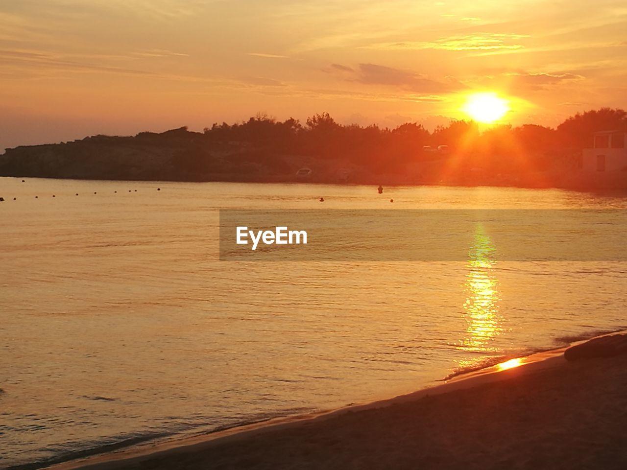 sunset, sky, water, beauty in nature, scenics - nature, orange color, sea, sun, land, beach, tranquility, nature, sunlight, tranquil scene, idyllic, silhouette, non-urban scene, sport, cloud - sky, outdoors