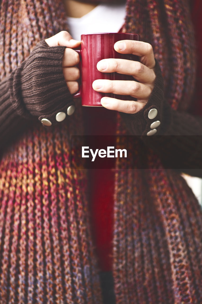 Close-Up Of Woman Holding A Red Mug