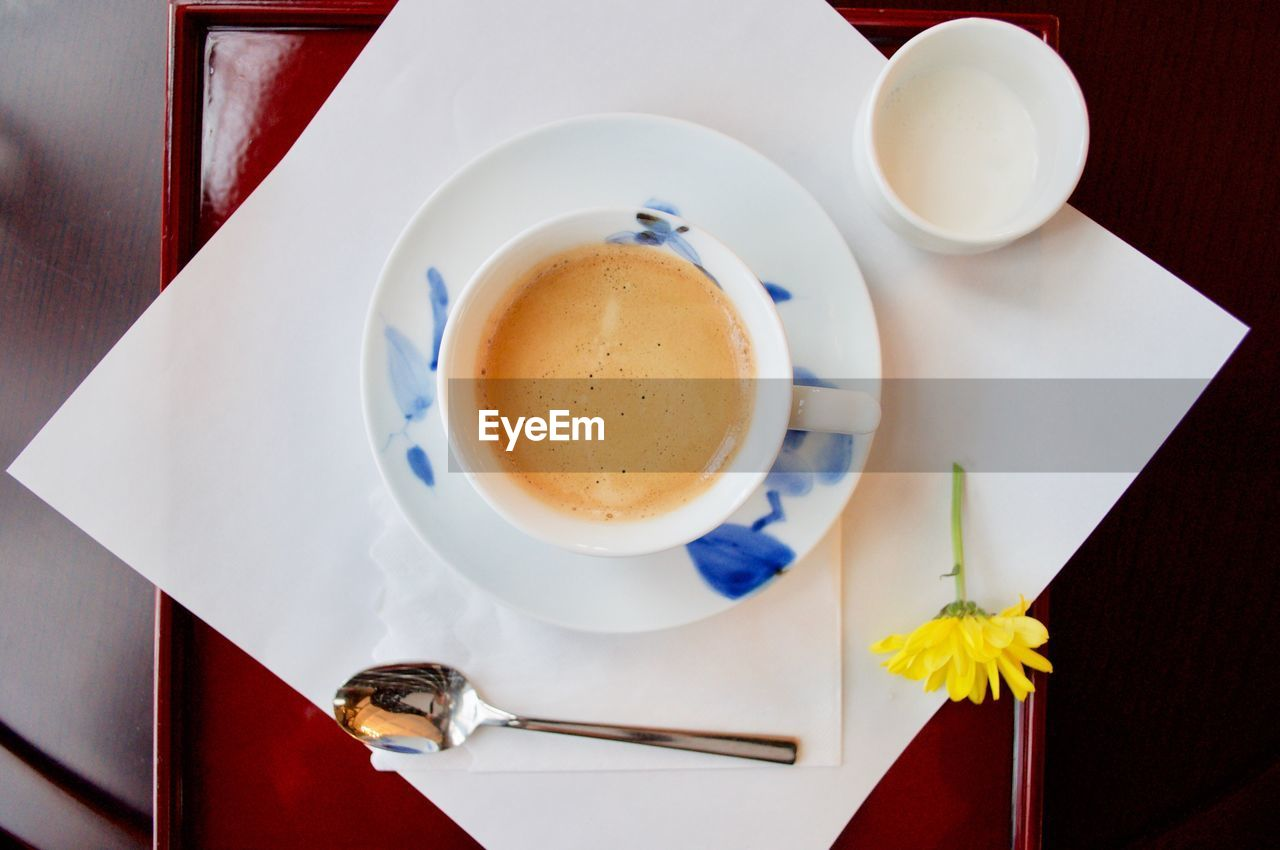 table, coffee cup, drink, refreshment, food and drink, saucer, coffee - drink, cup, high angle view, directly above, indoors, plate, no people, freshness, frothy drink, close-up, food, day