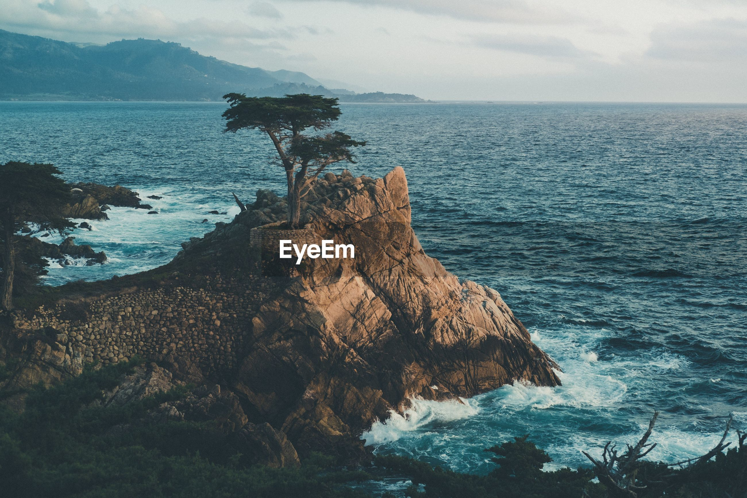 SCENIC VIEW OF SEA BY CLIFF